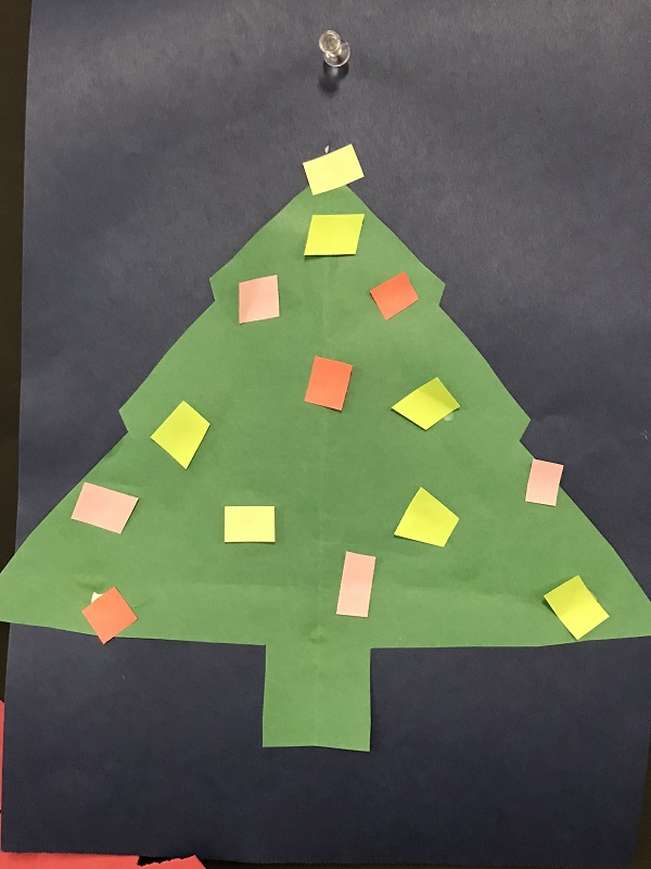 Paper cut out Christmas tree with colored square light bulbs
