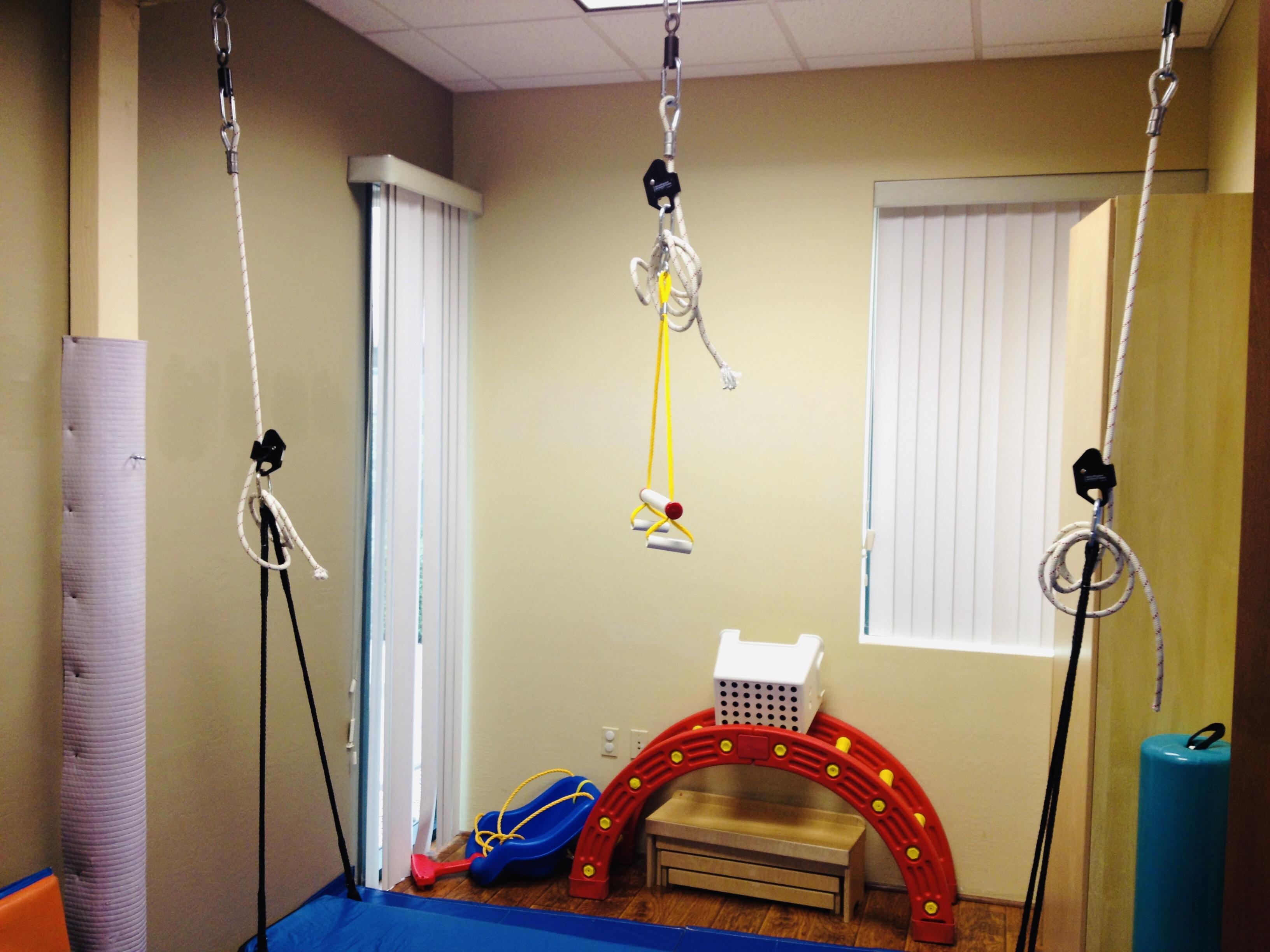 Suspended indoor rope swing