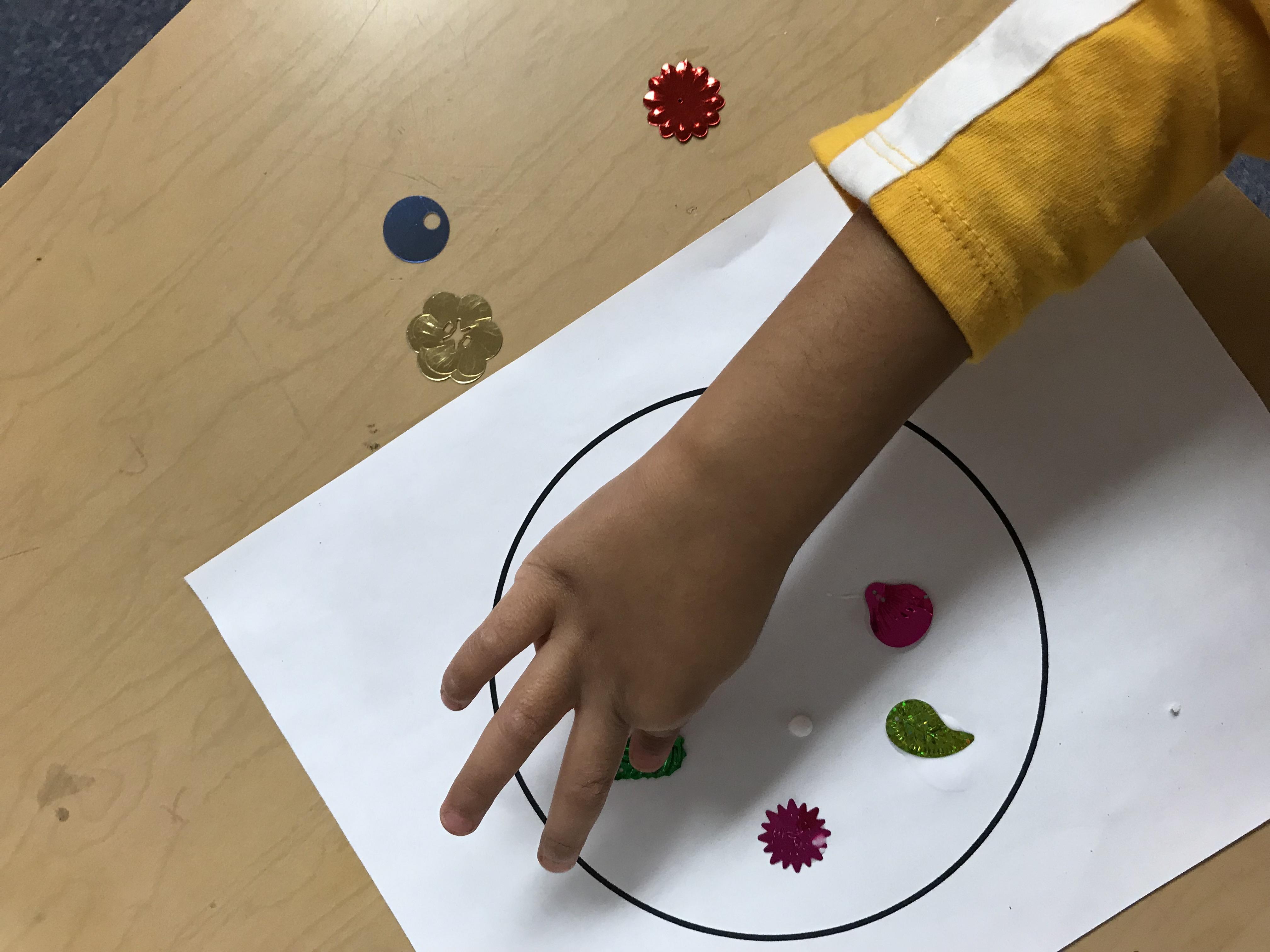 Kid placing various shapes in print out circle