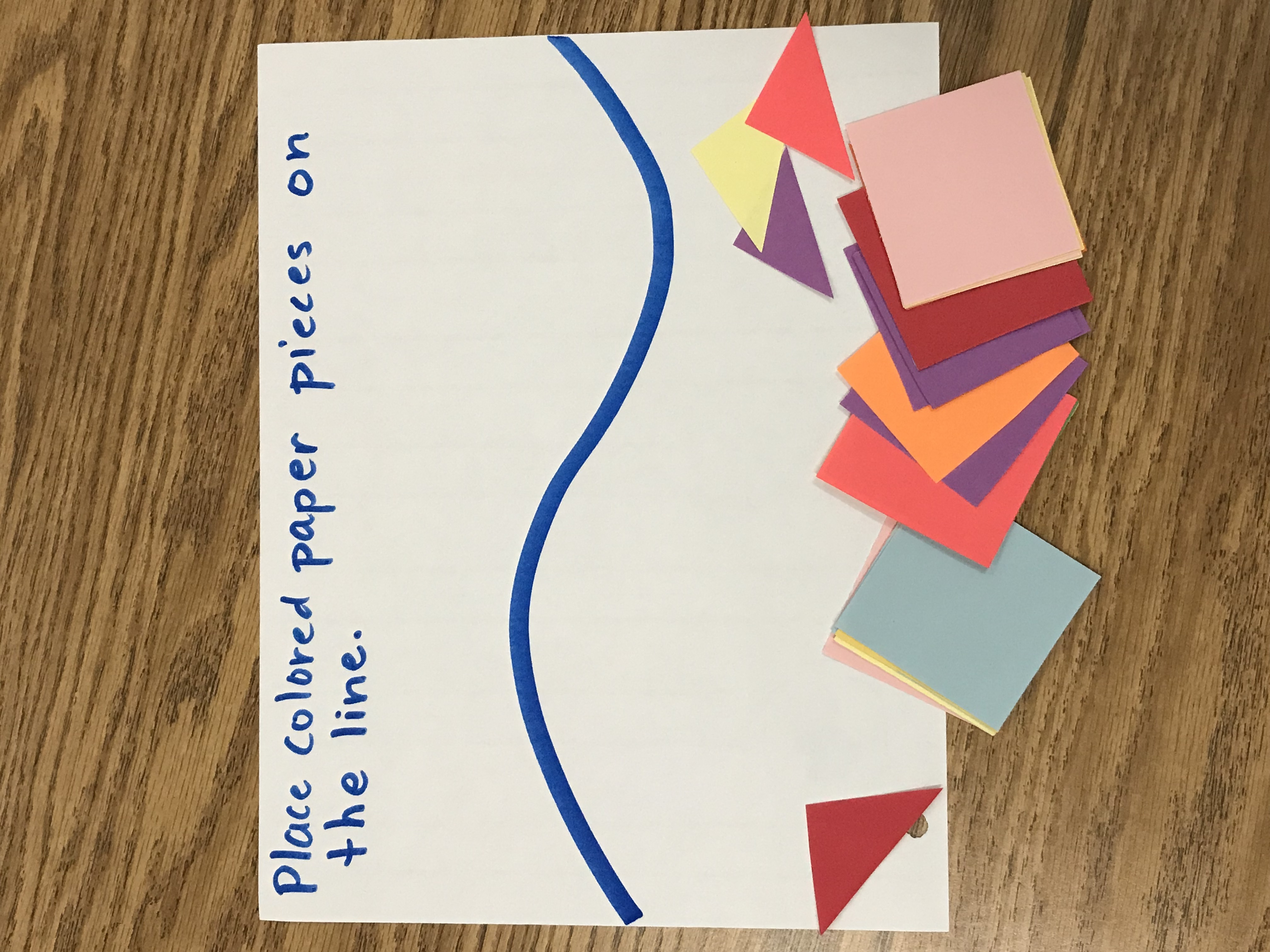 Colored paper squares and paper with curvy line