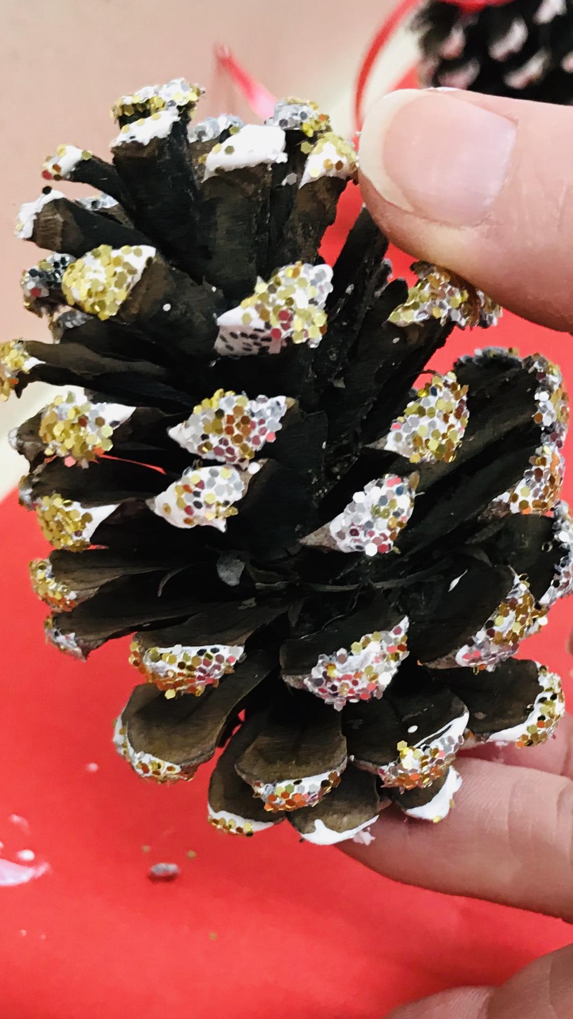 Gold glittered pine cone