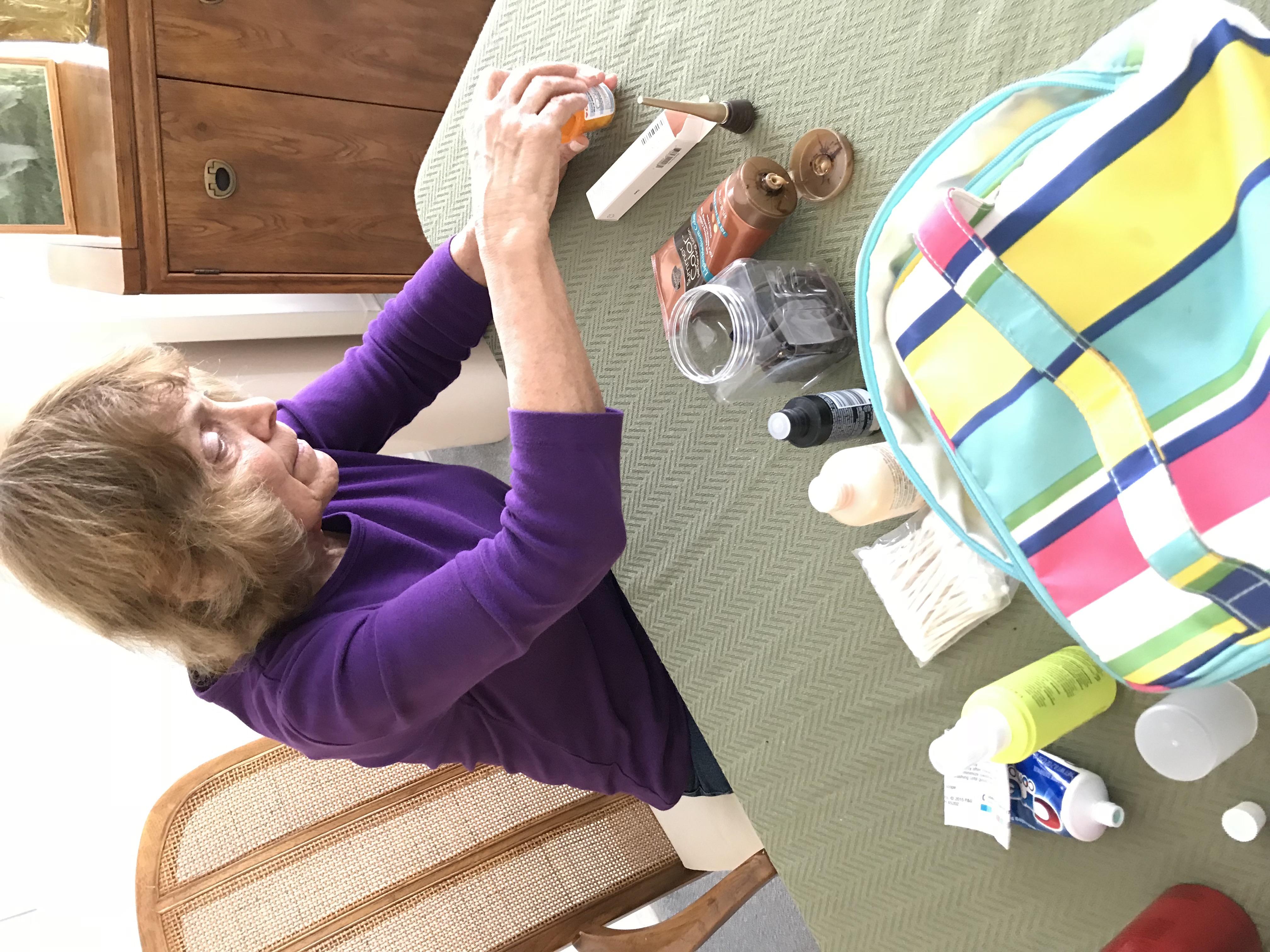 Woman organizing make up bag