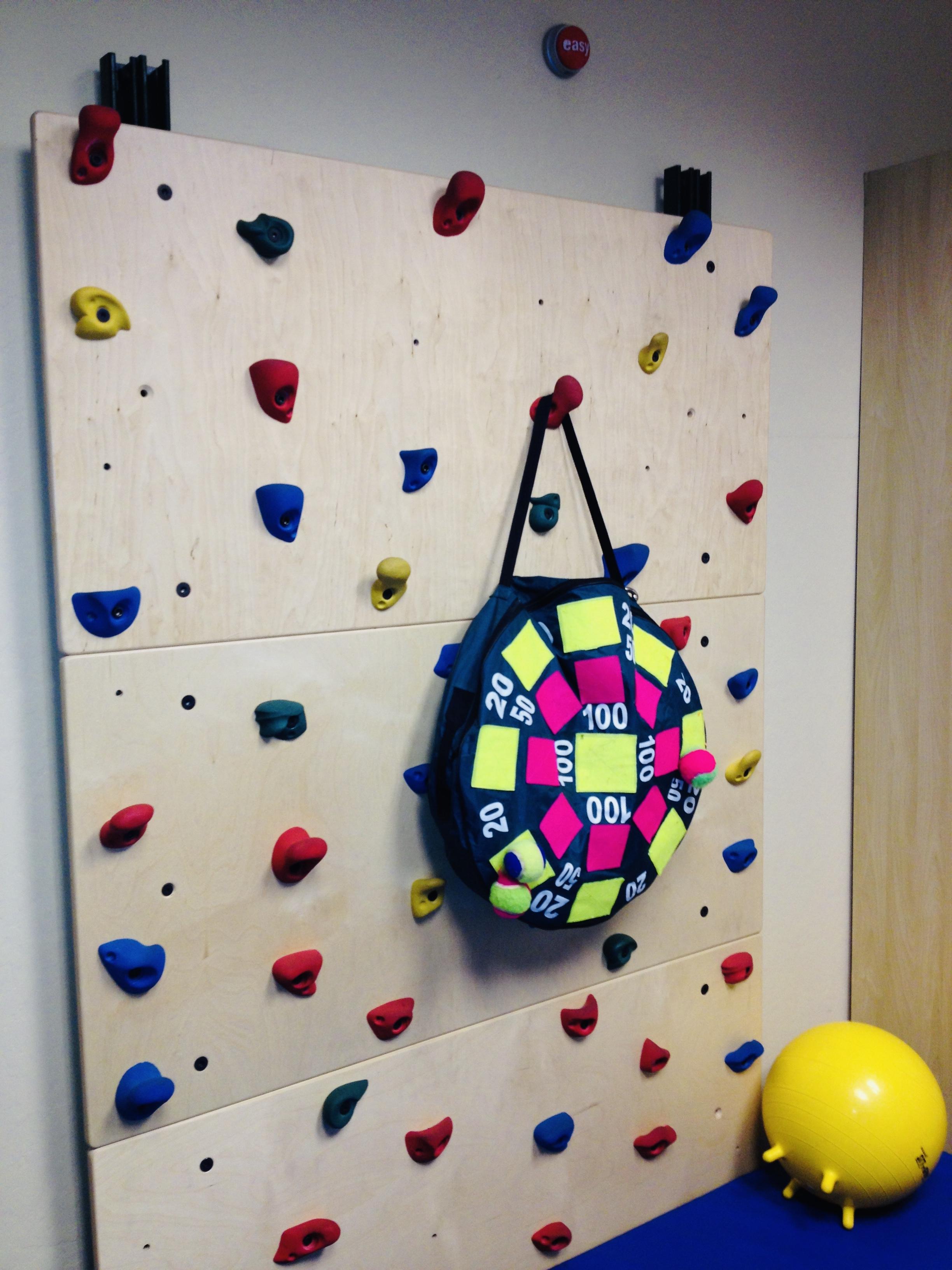 Velcro dart board hanging from rock climbing wall