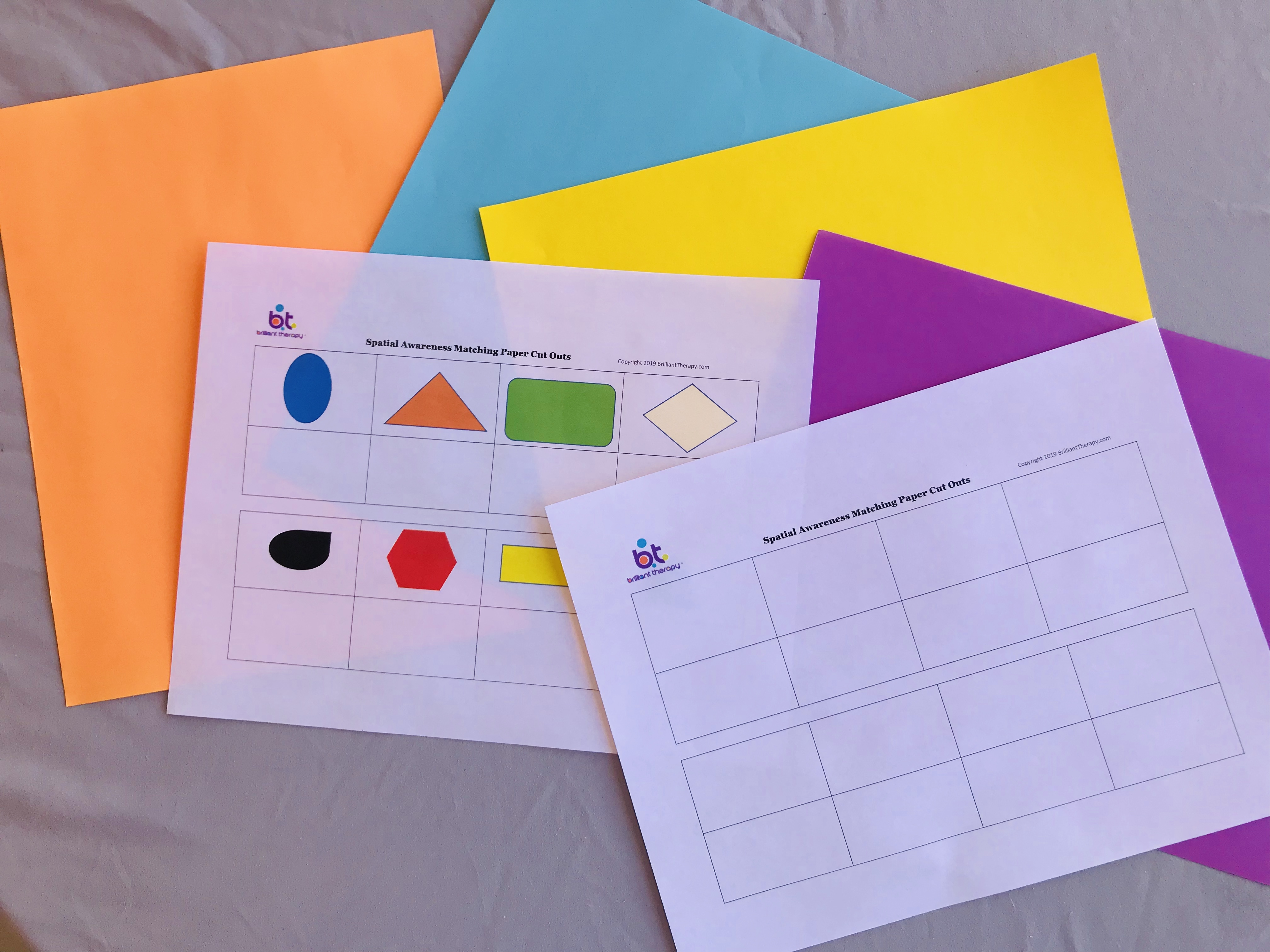 Spatial awareness sheets and colored papers