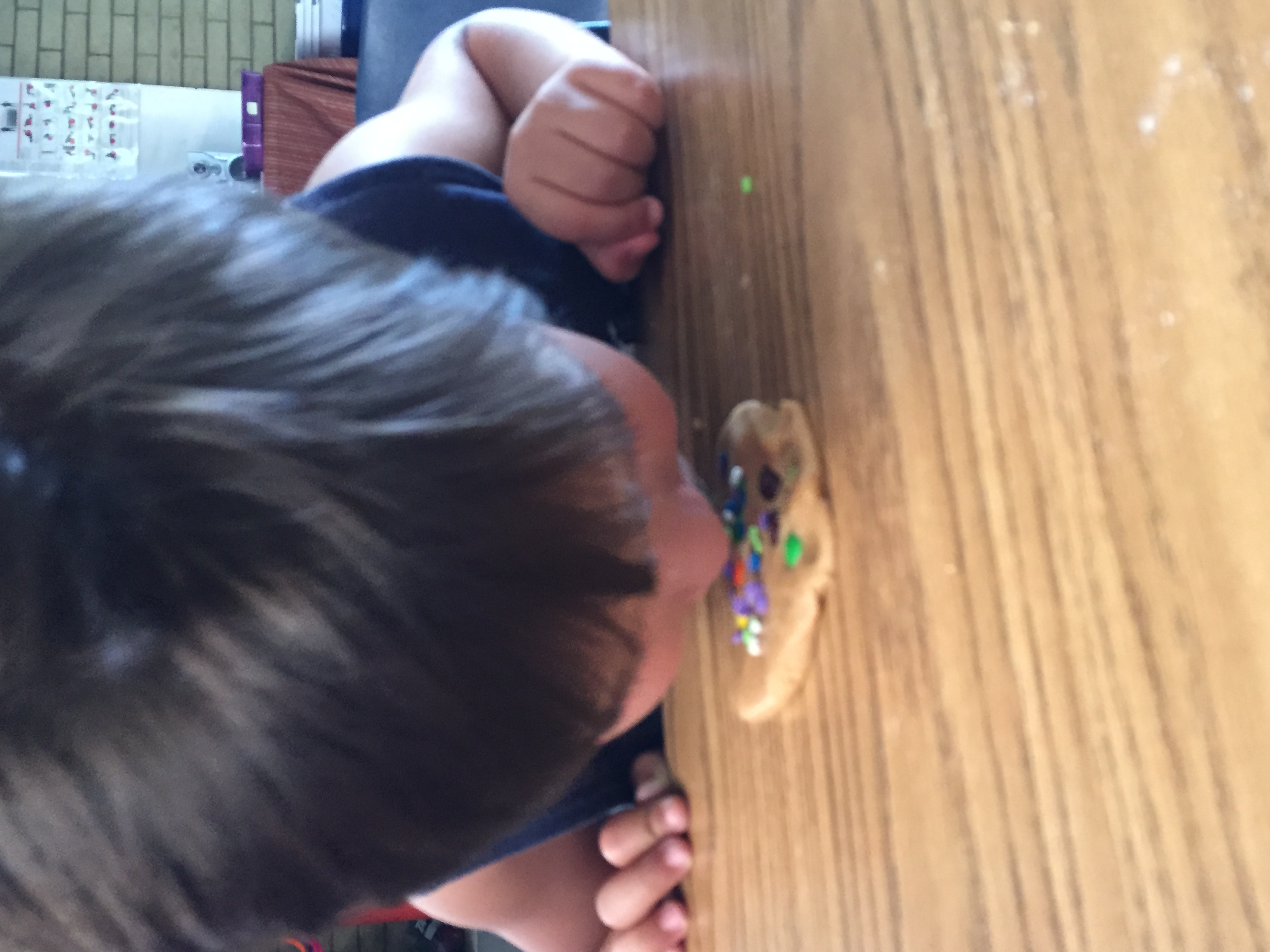 Young boy eating cookie