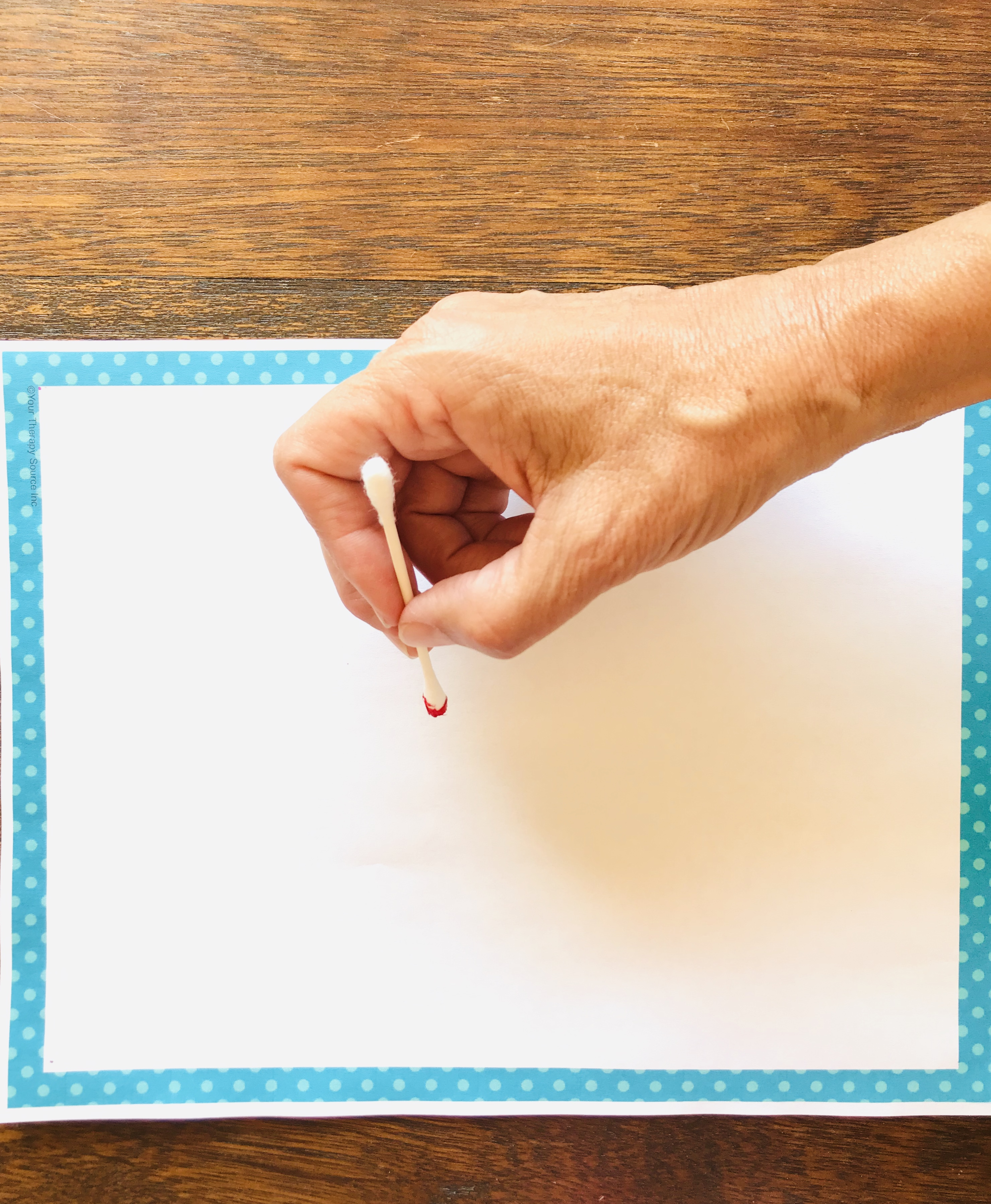 Drawing with red paint Q-tip paper