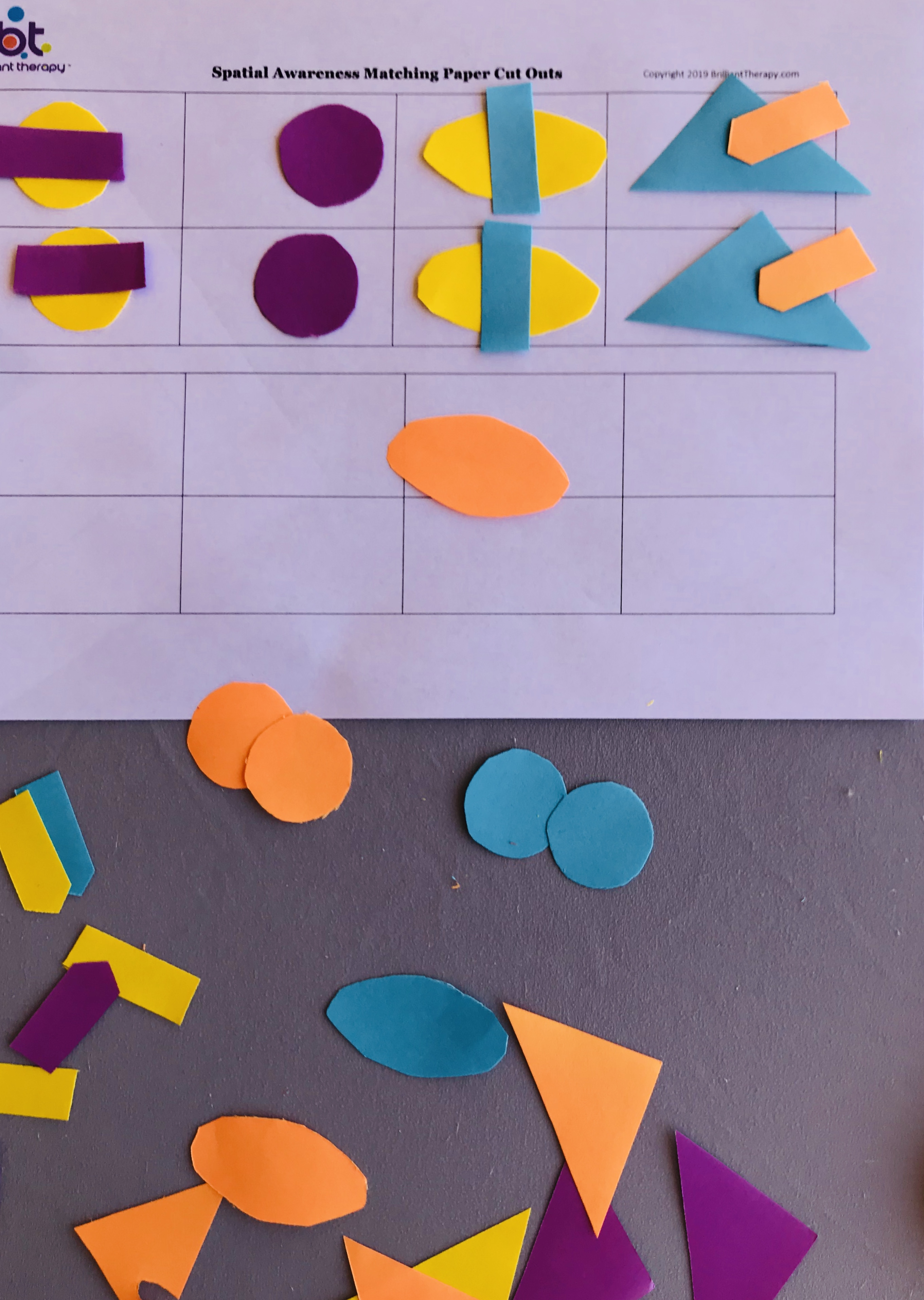 Cut out shapes on spatial awareness sheets
