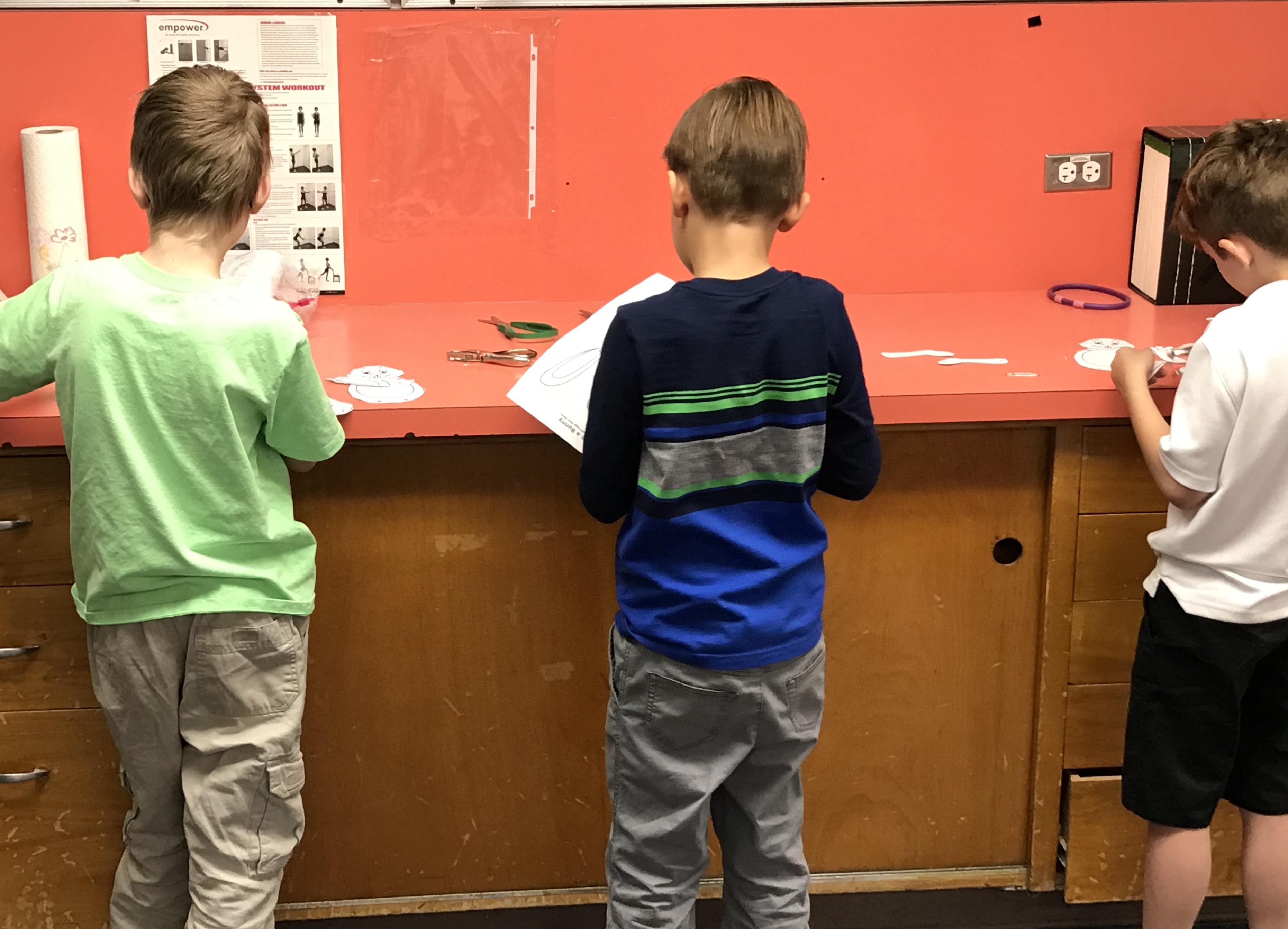 Kids making crafts on counter