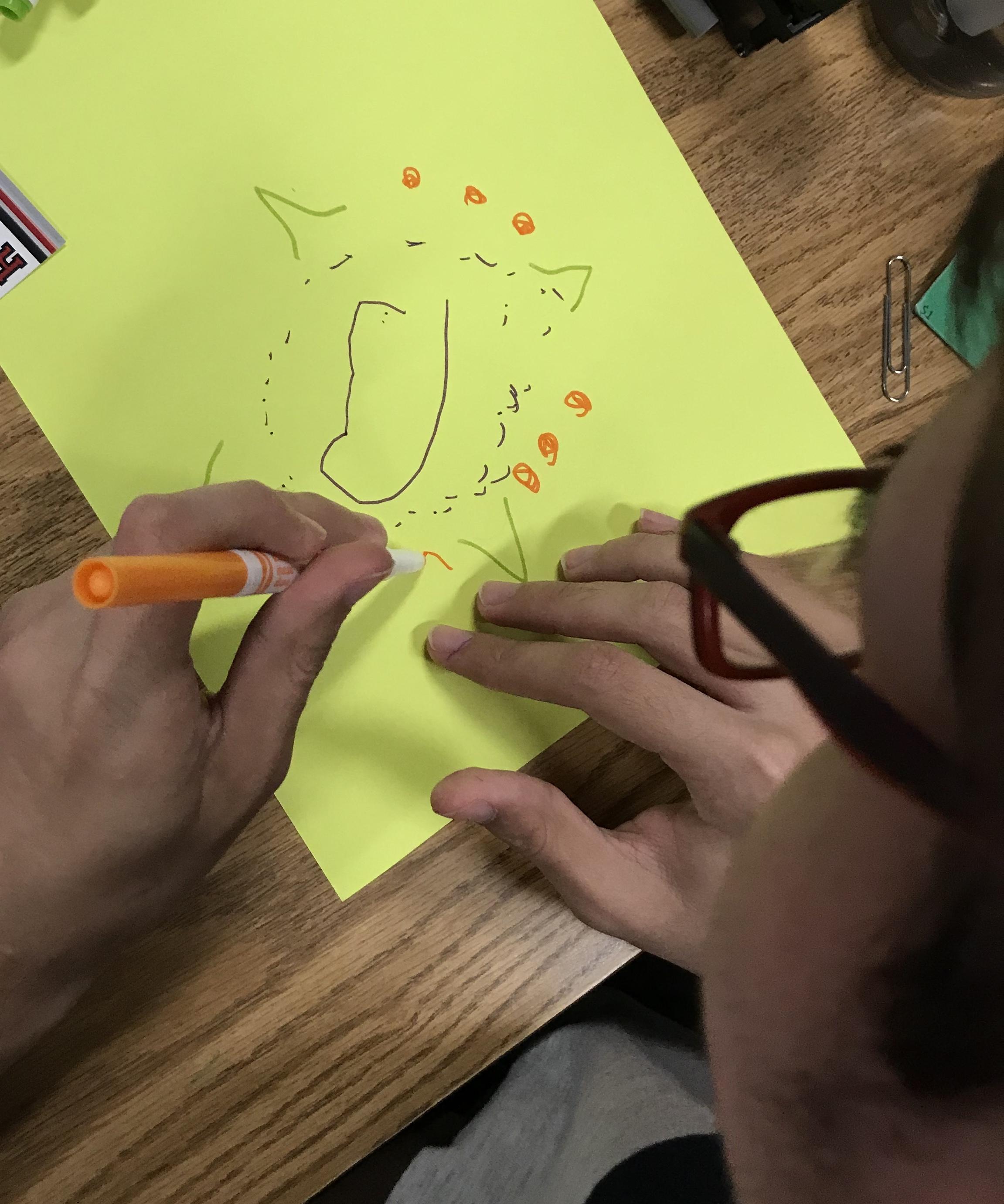 Kid drawing mandala
