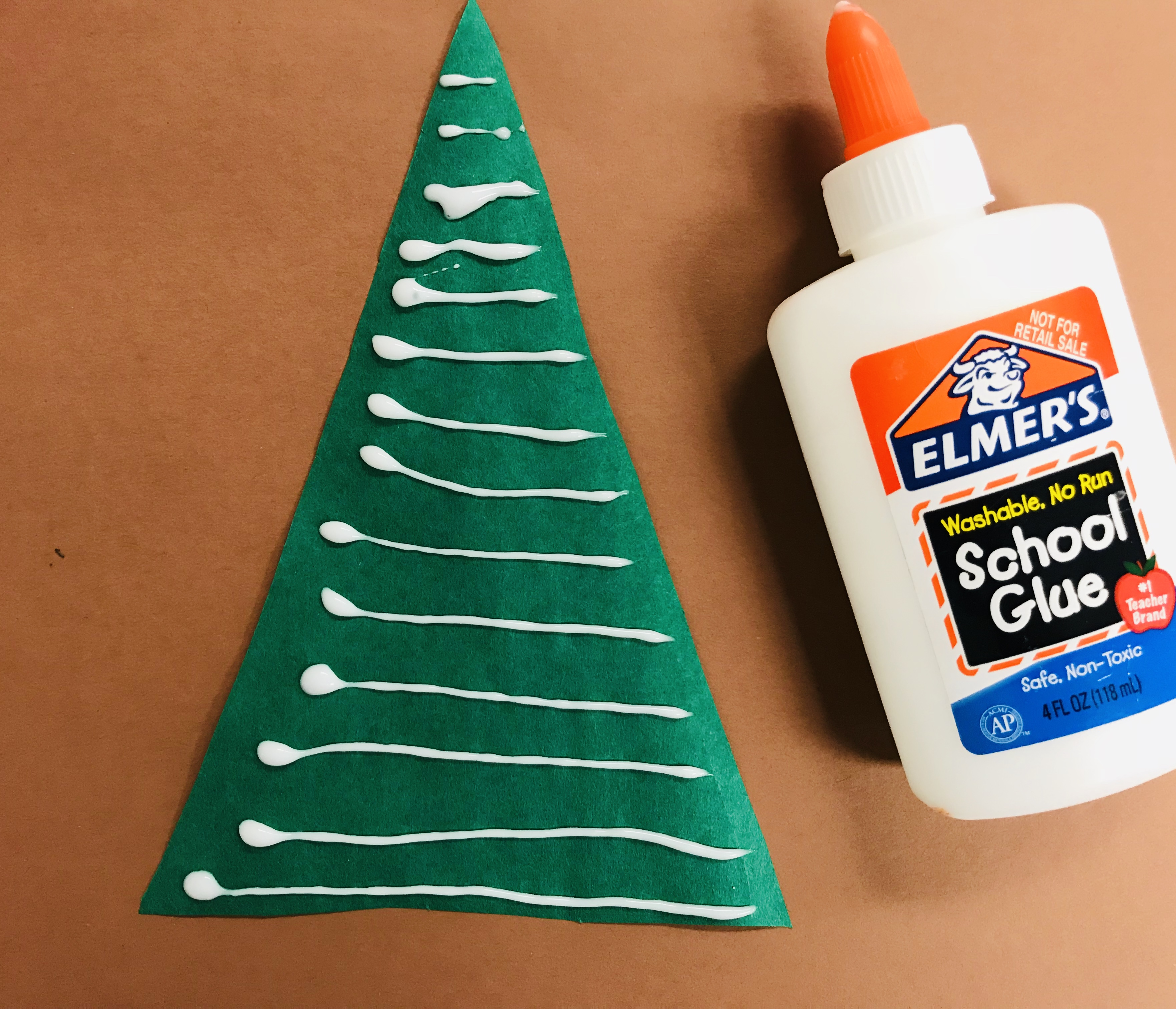 Glue lines on paper Christmas tree