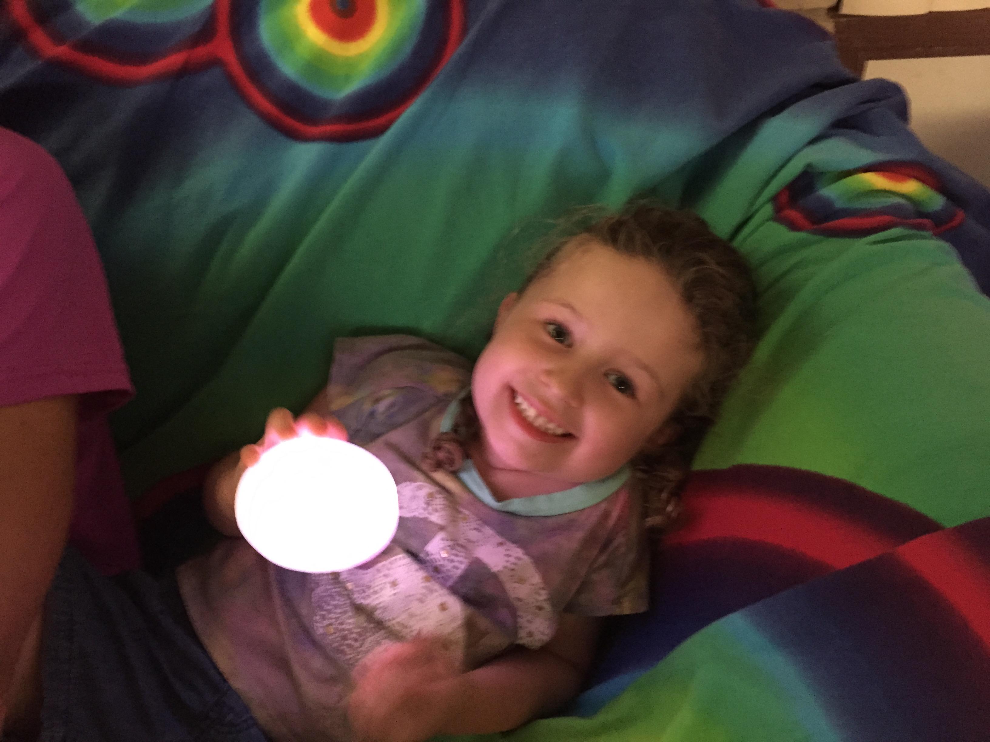 Little girl holding glowing magic egg