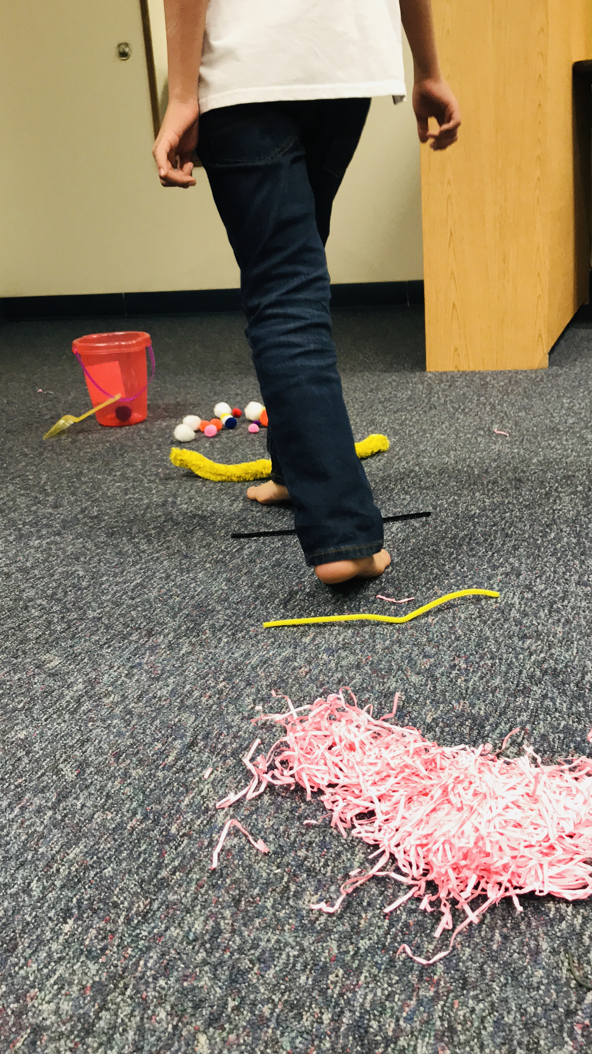 Walking over various string items on carpet
