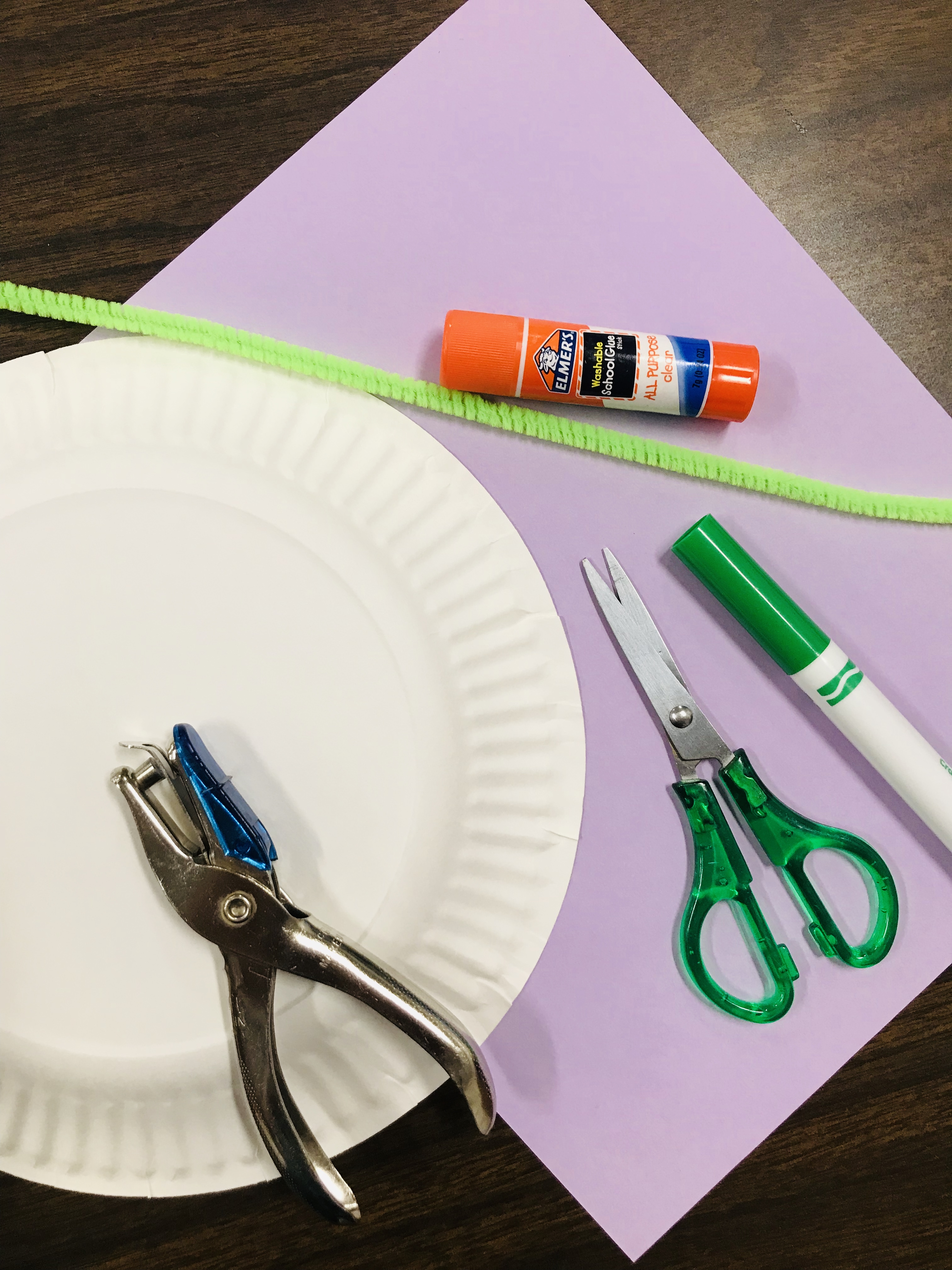 Paper puncher, plate, sheet with scissors, marker, and glue