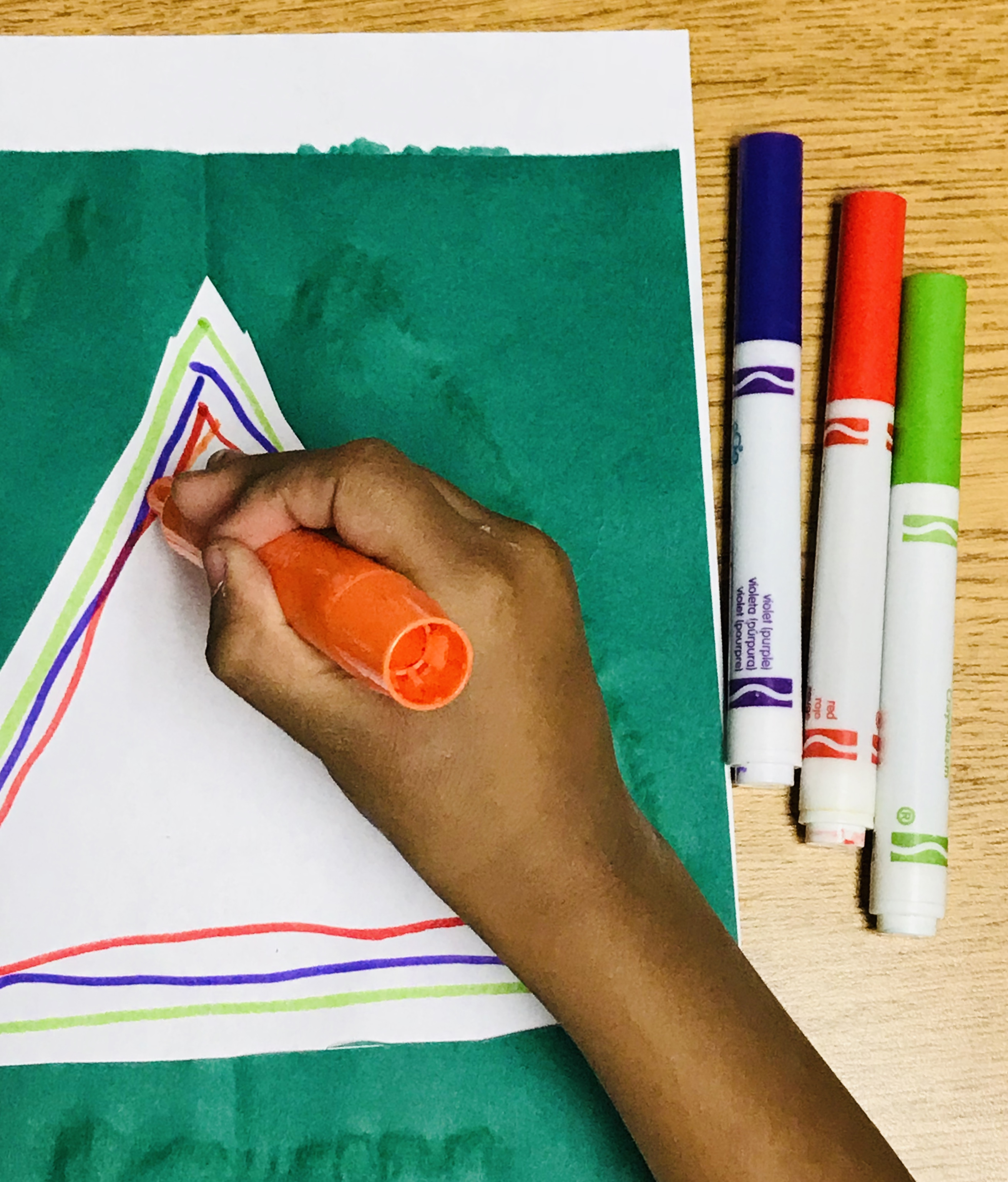 Drawing triangles inside paper Christmas tree outline