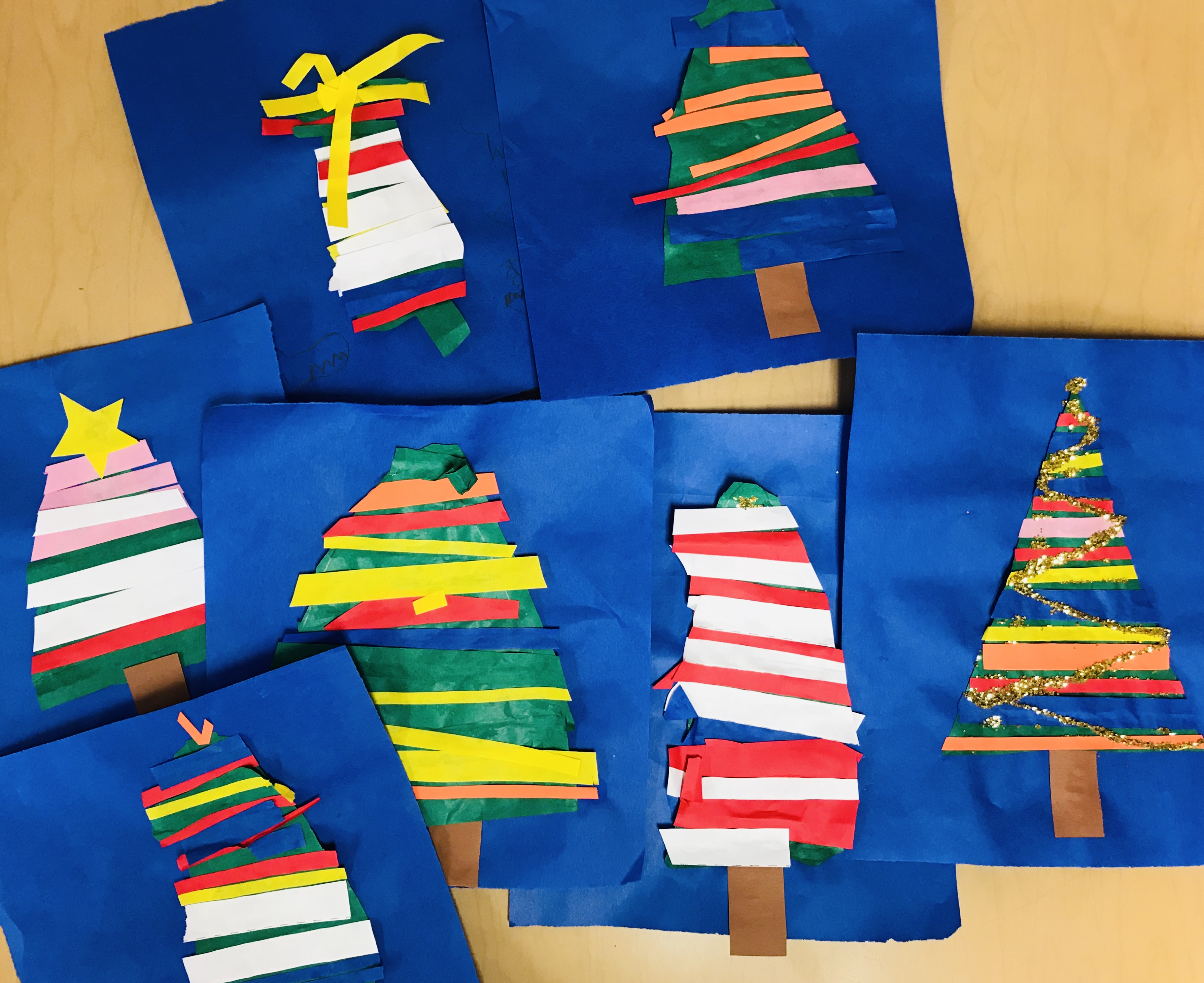Completed paper strips Christmas trees
