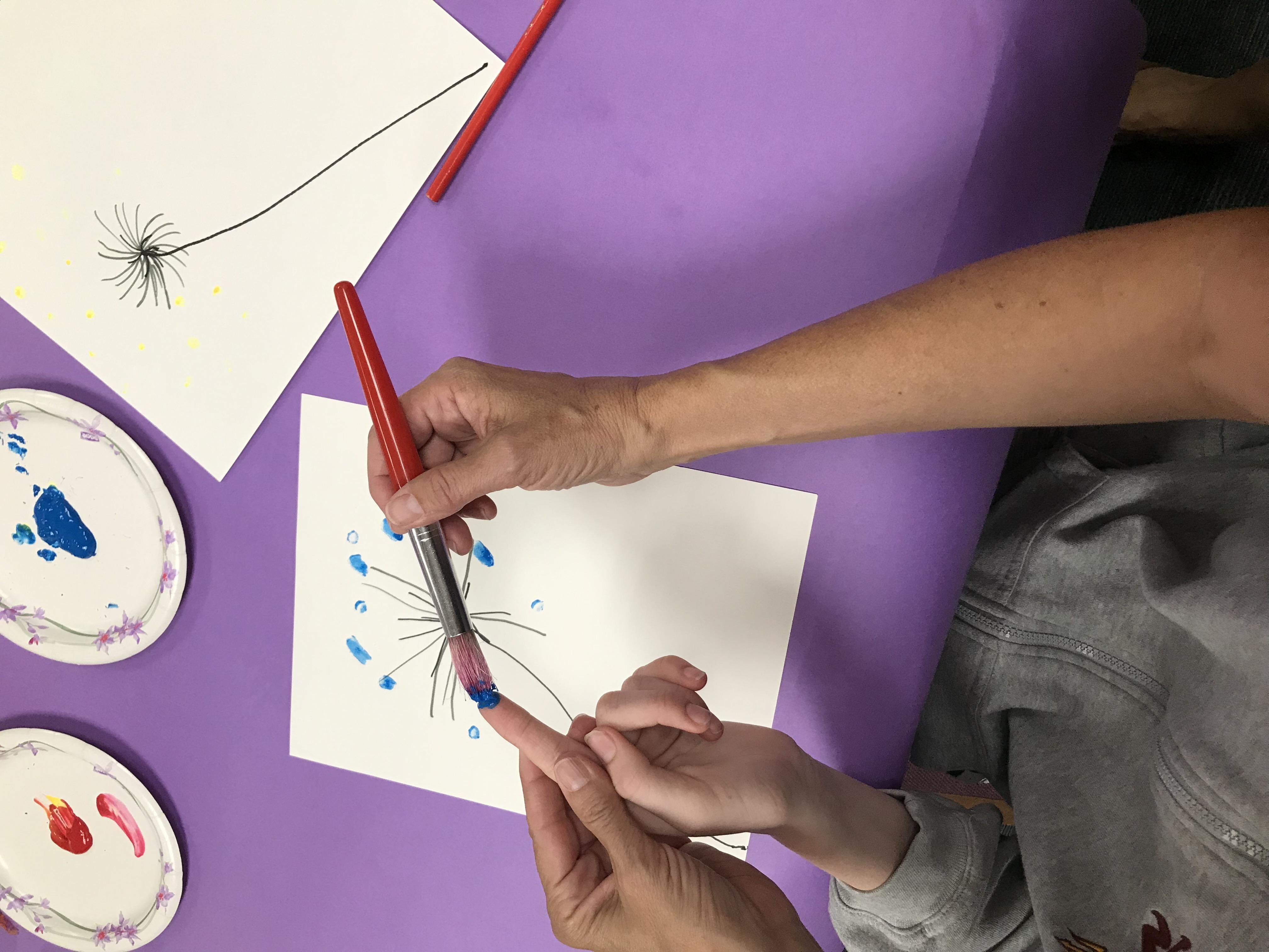 Applying paint to finger tips