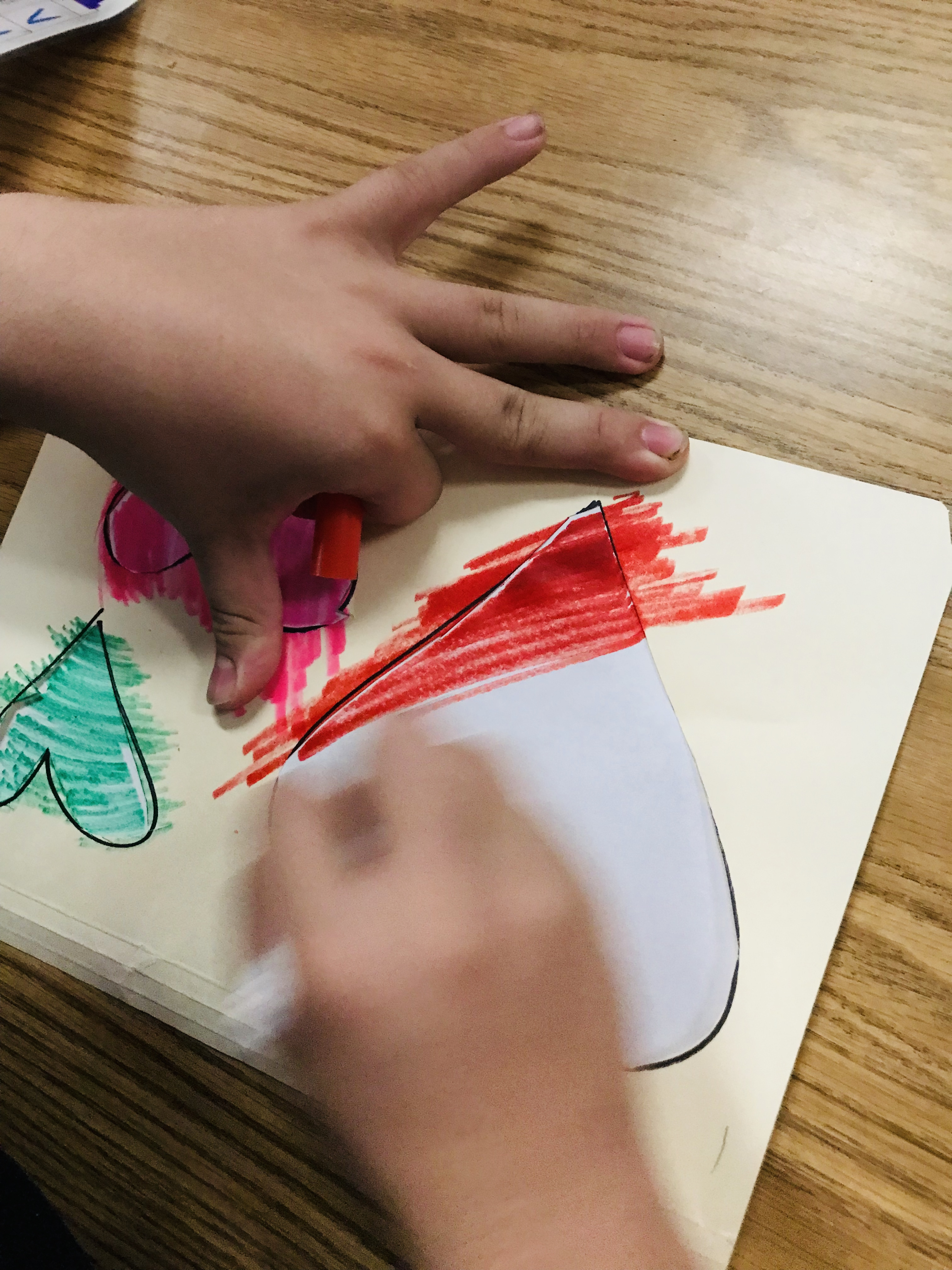 Coloring paper hearts on folder