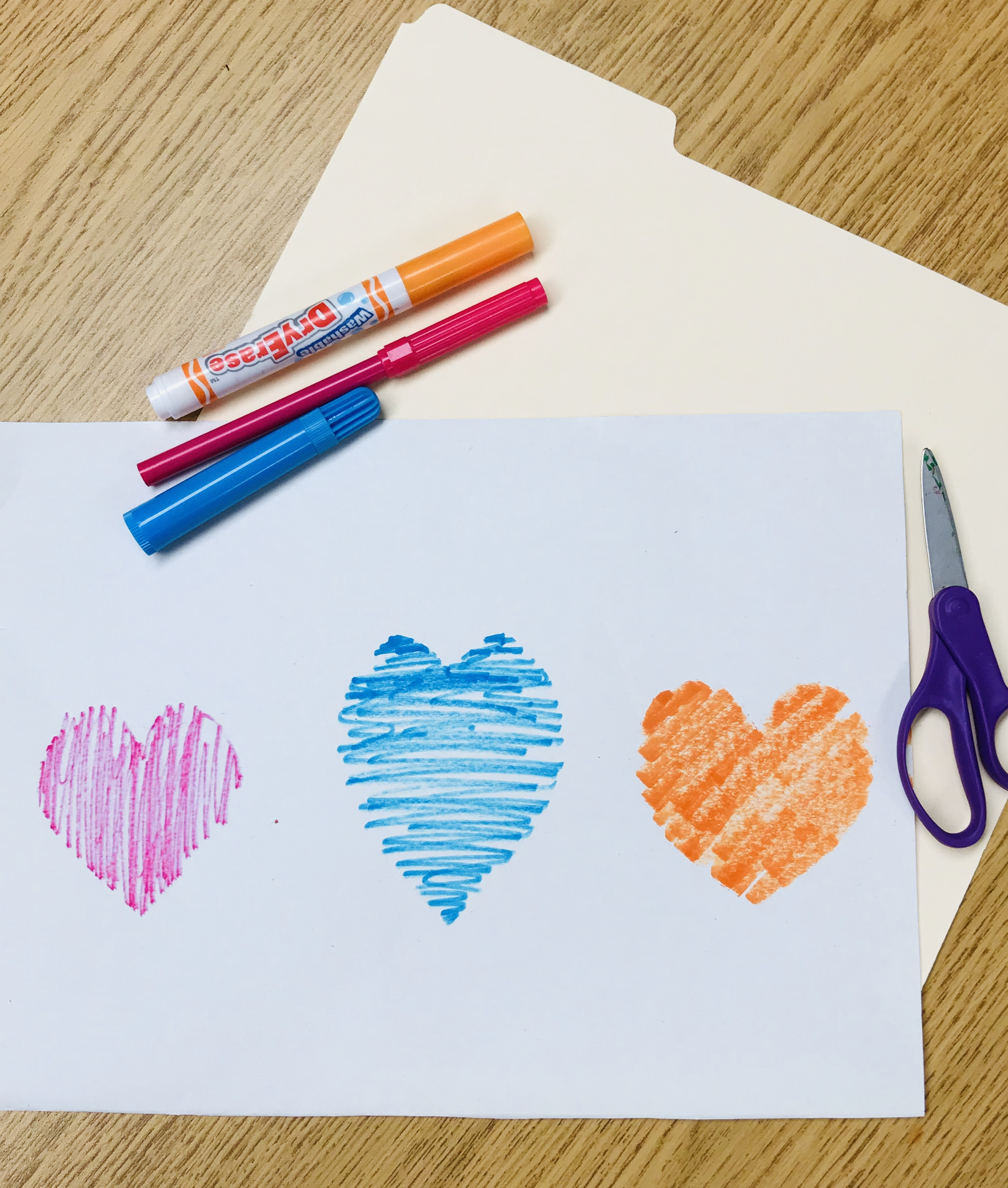 Markers and drawn hearts
