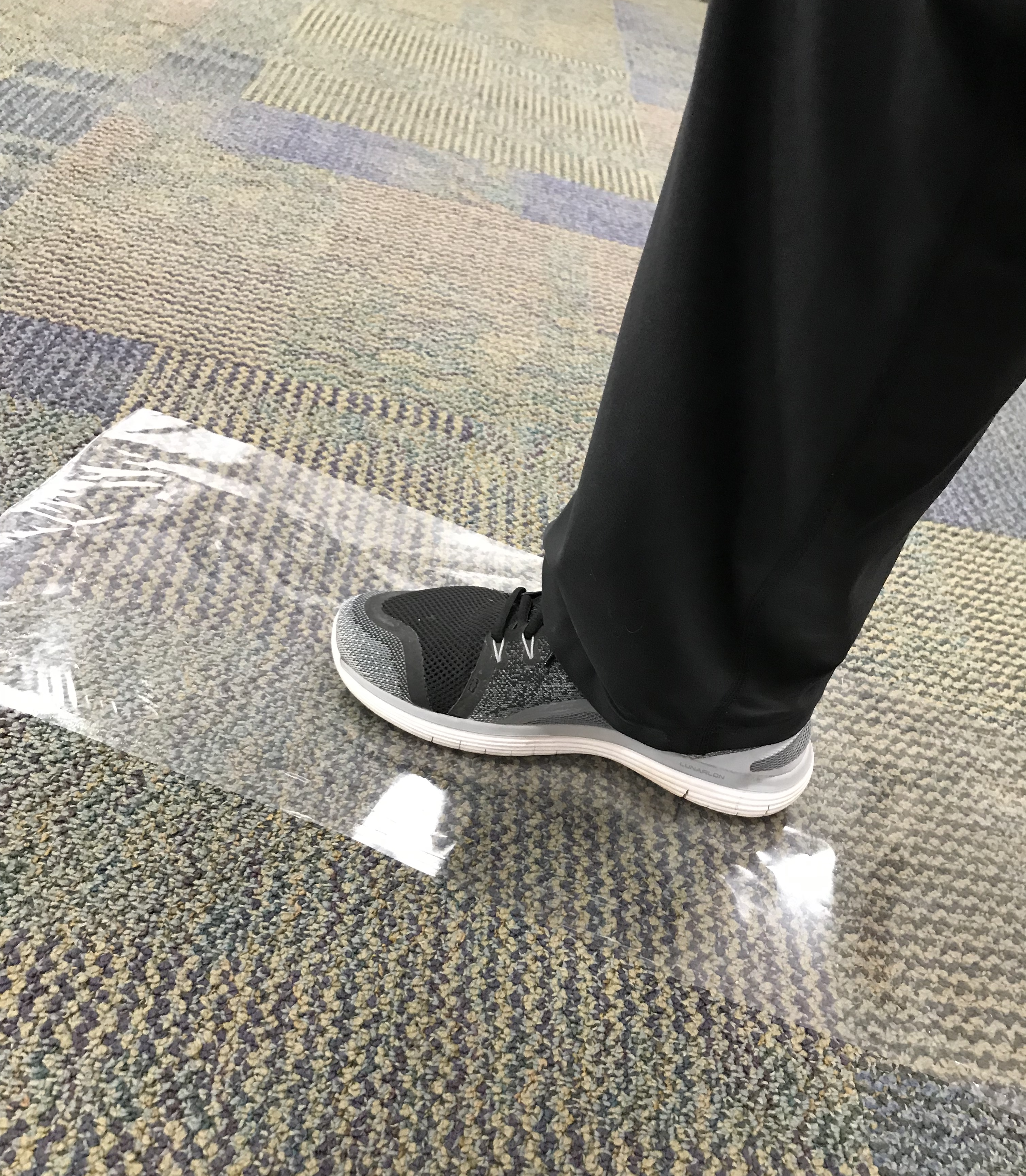 Stepping on plastic sheet placed on carpet