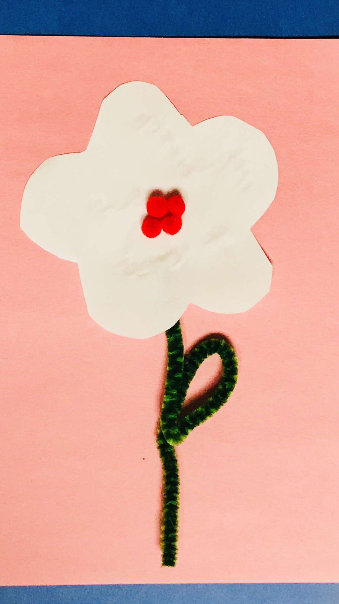 Paper flower with pipe cleaner stem