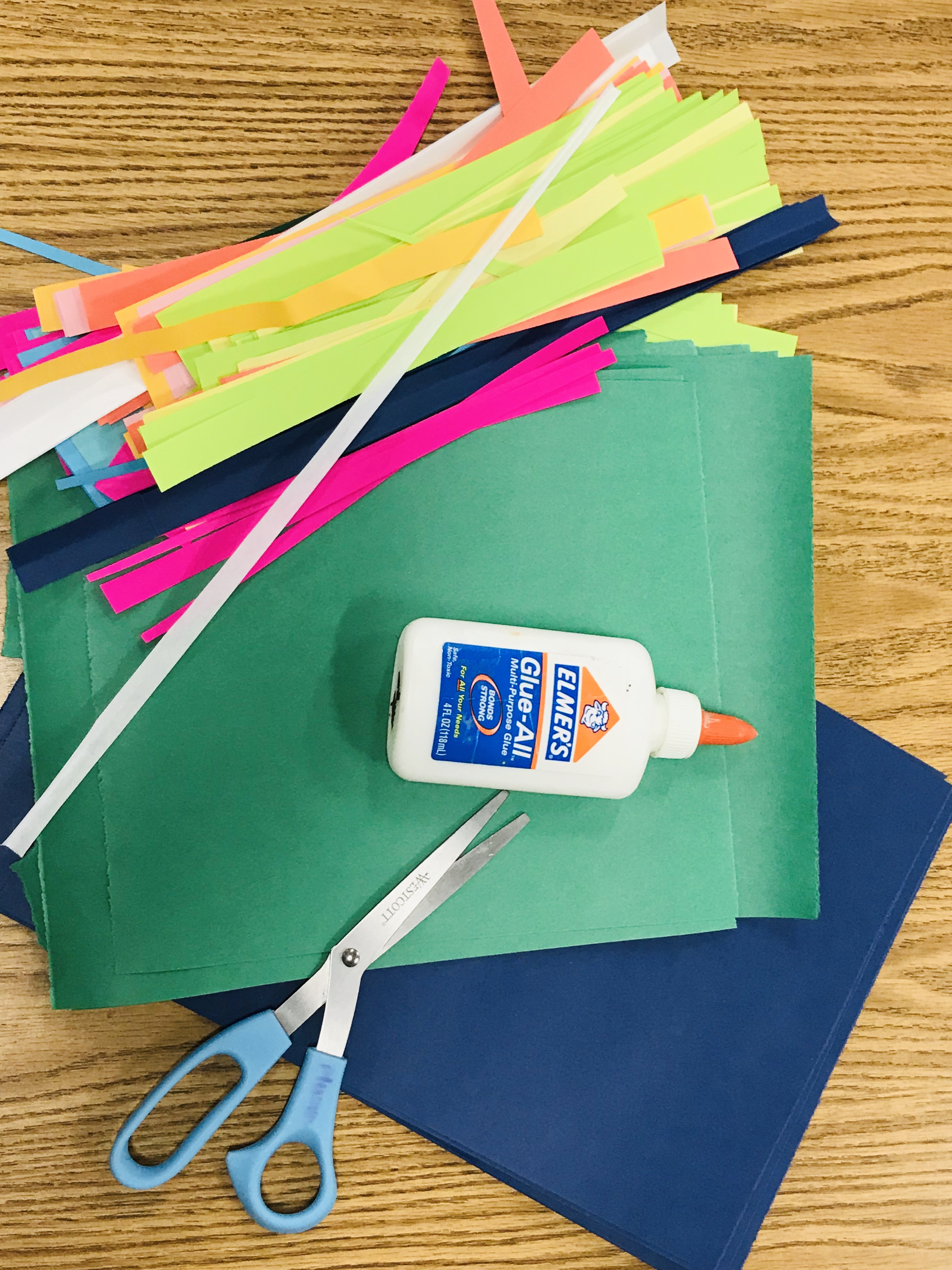 Paper sheets and strips with glue and scissors