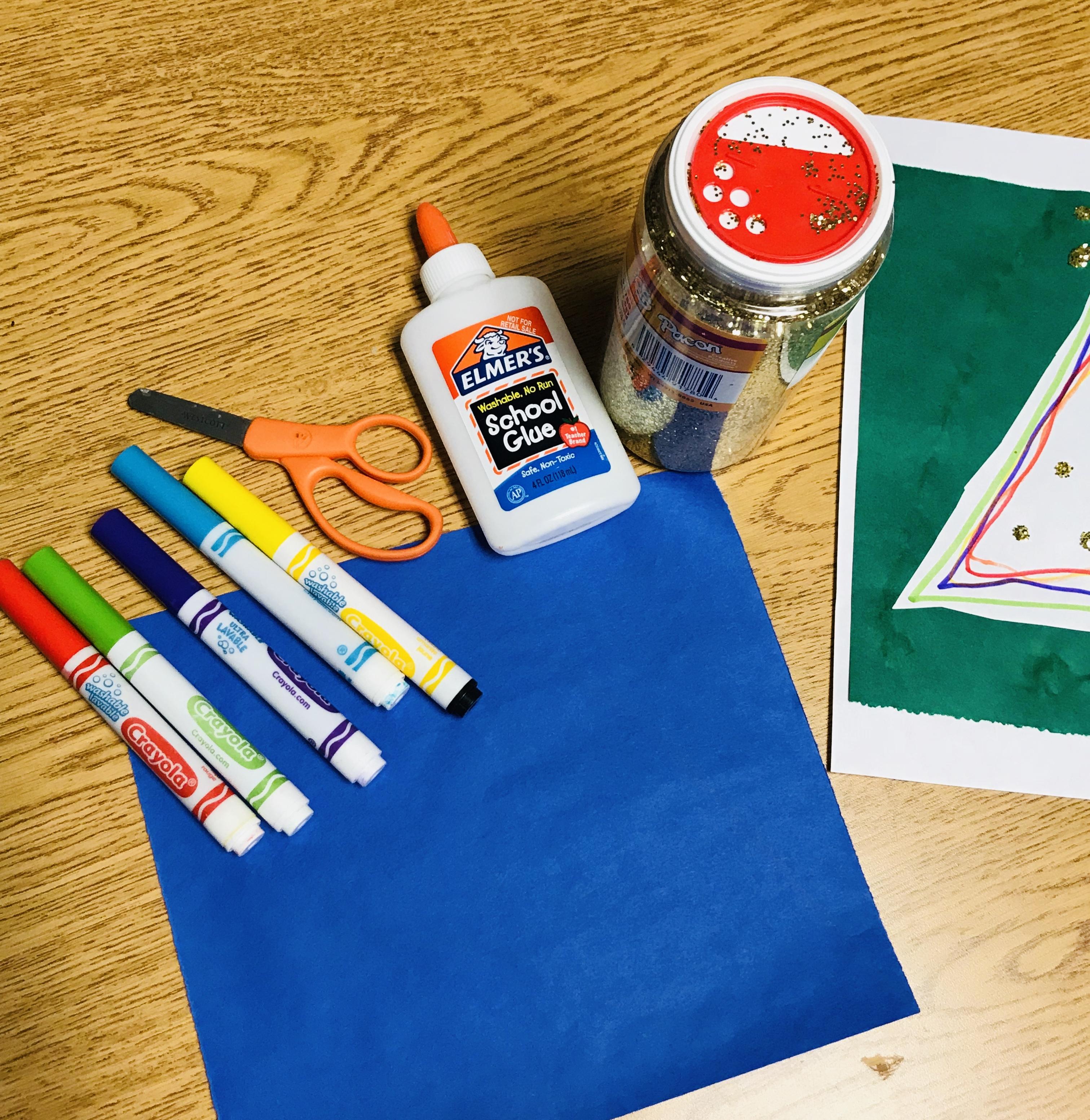 Markers, scissors, glue, glitter, and paper