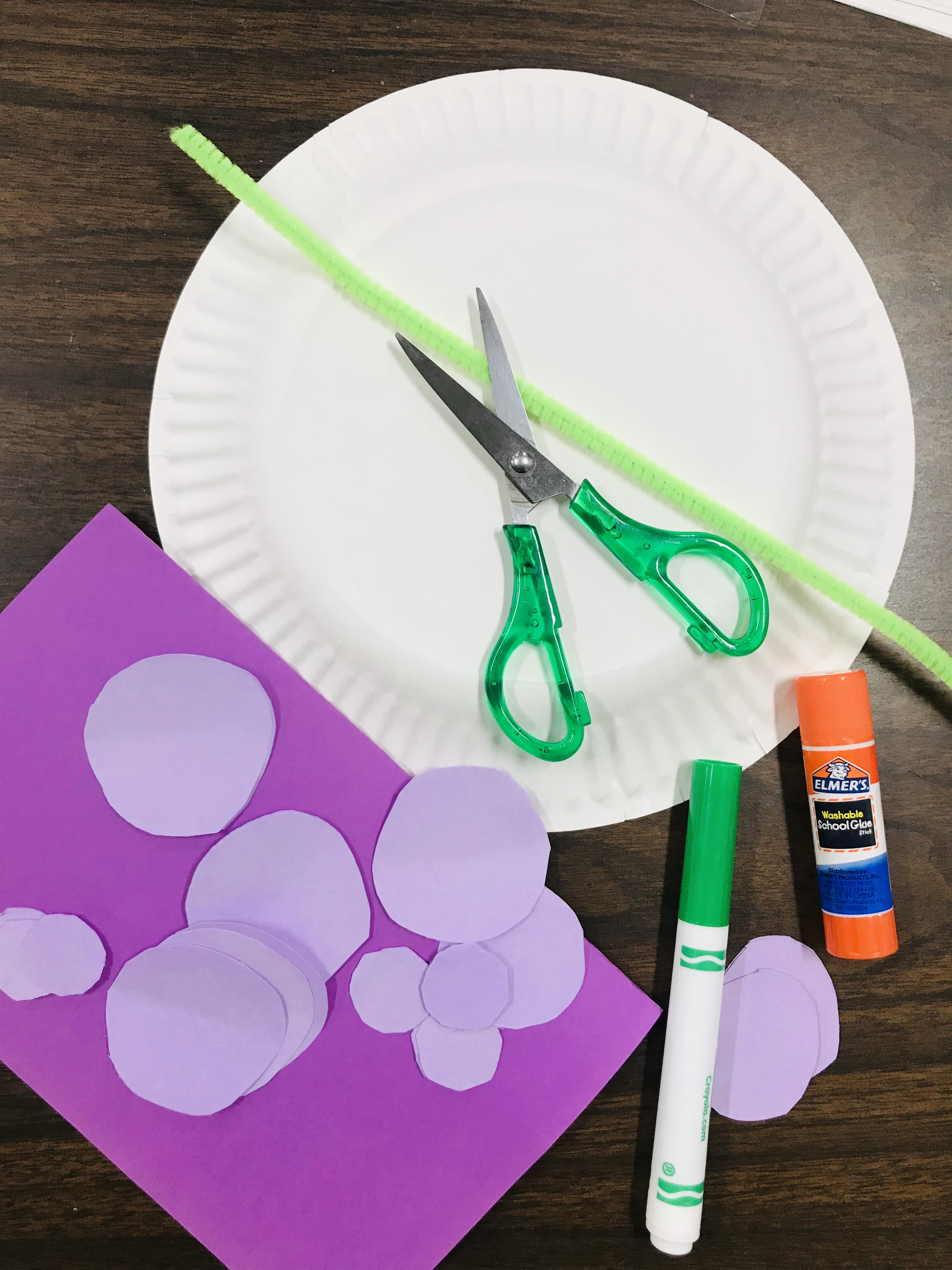 Paper plate and sheet with scissors, marker, and glue