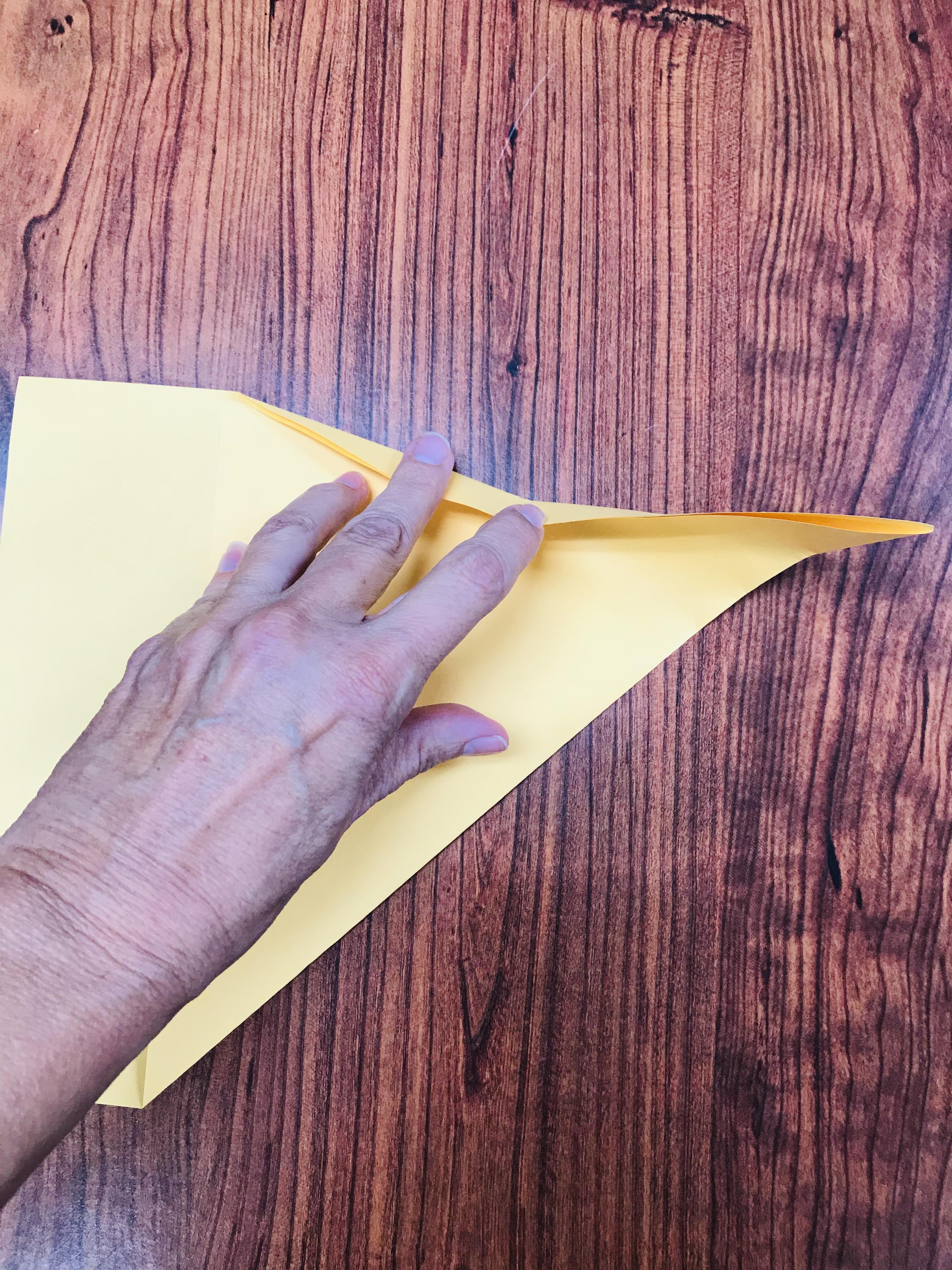 Folding yellow paper