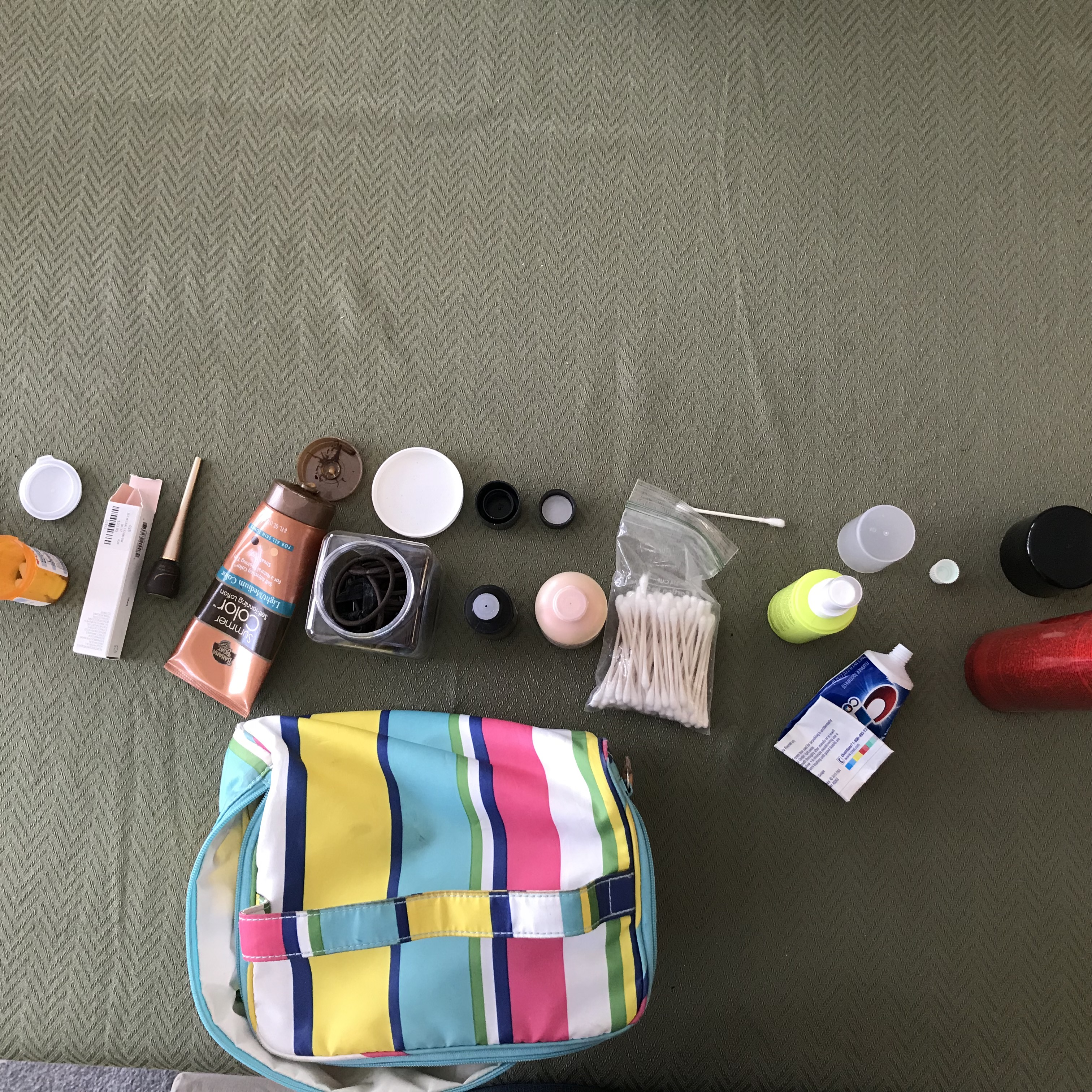 Assorted items from a makeup bag