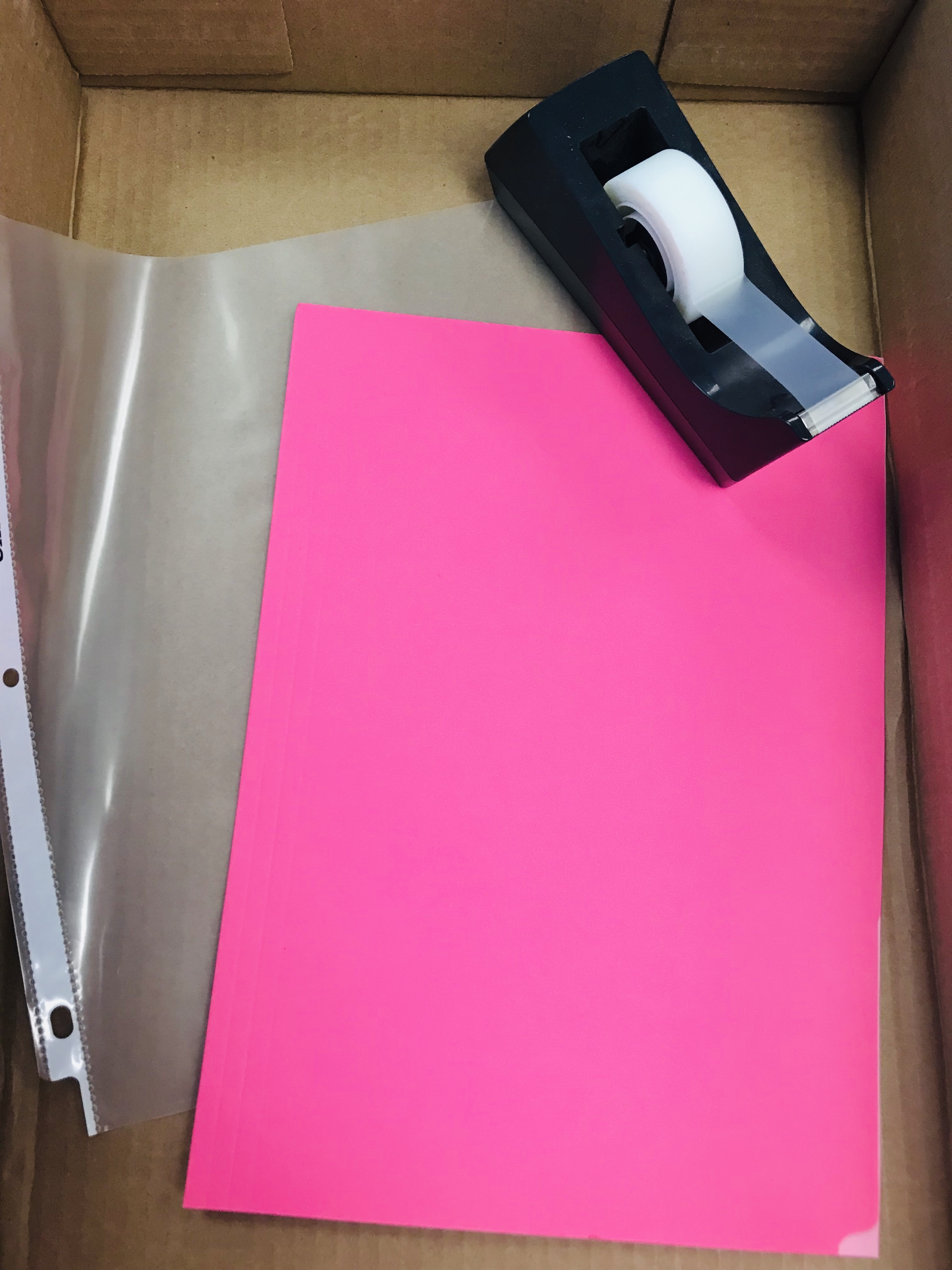 Pink paper, tape, and sheet protector