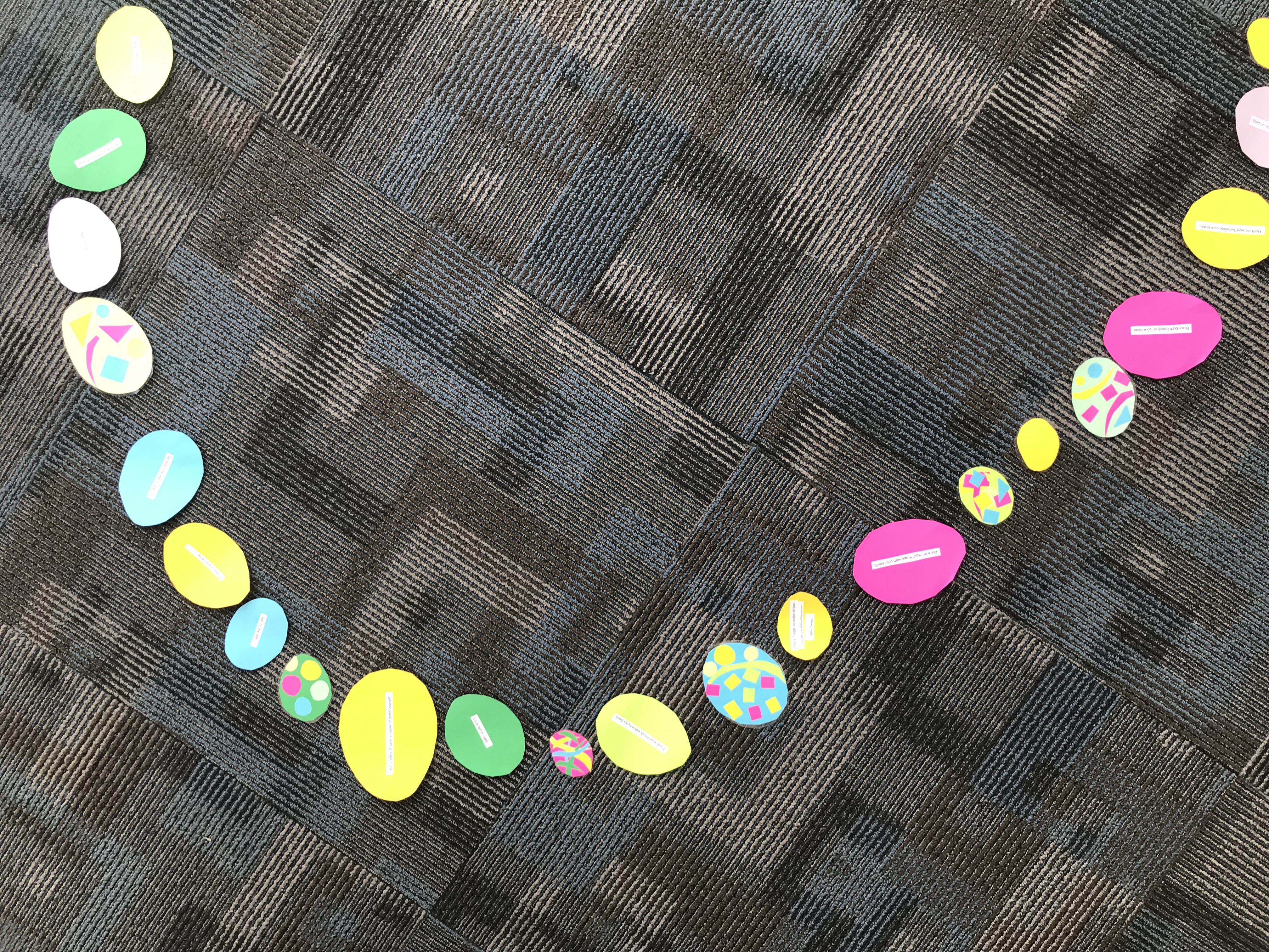 Colorful paper eggs on floor