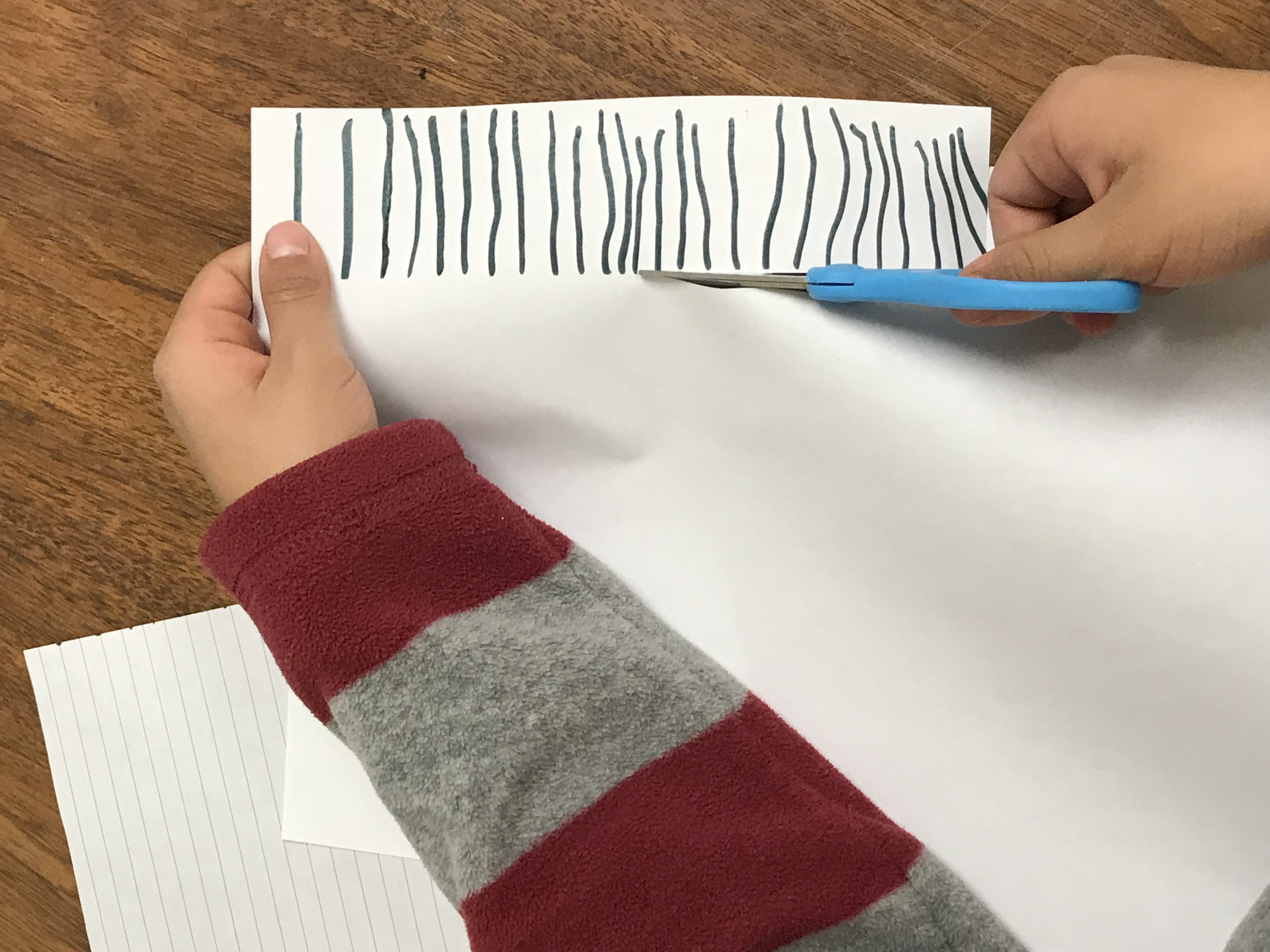 Cutting lined paper strip