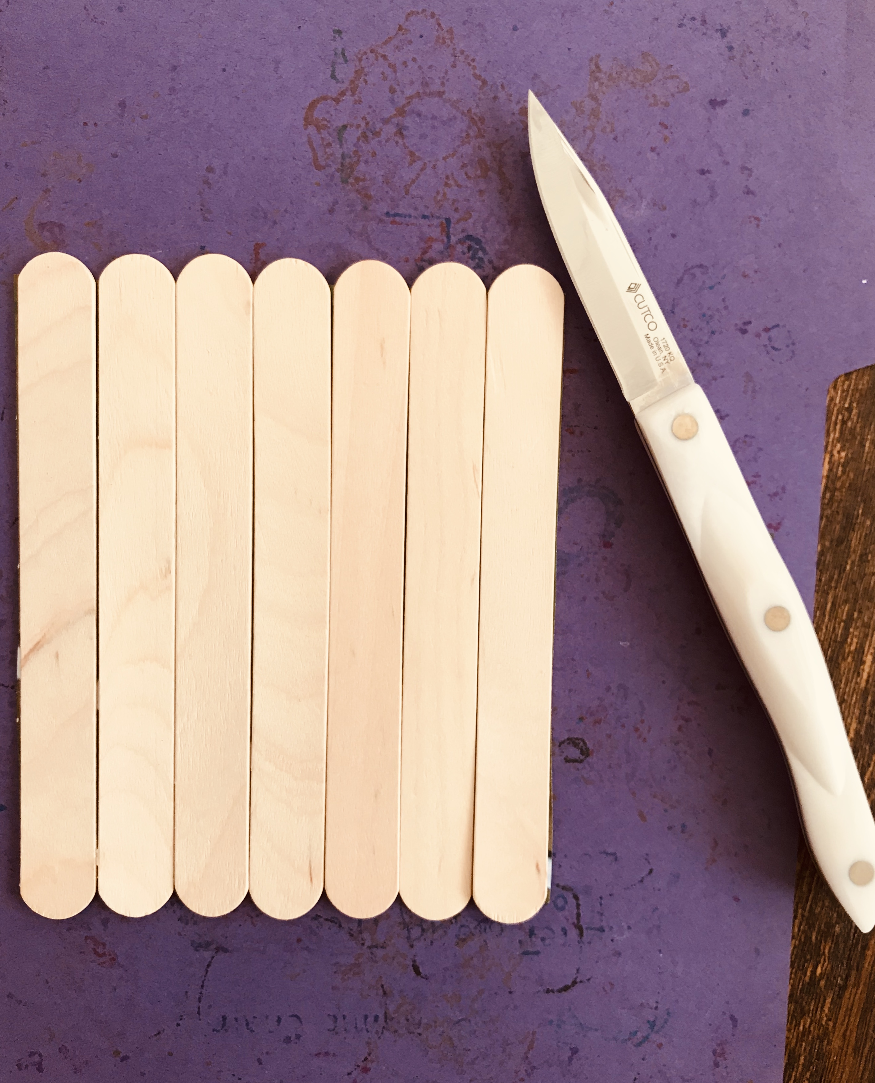 Popsicle sticks and a knife