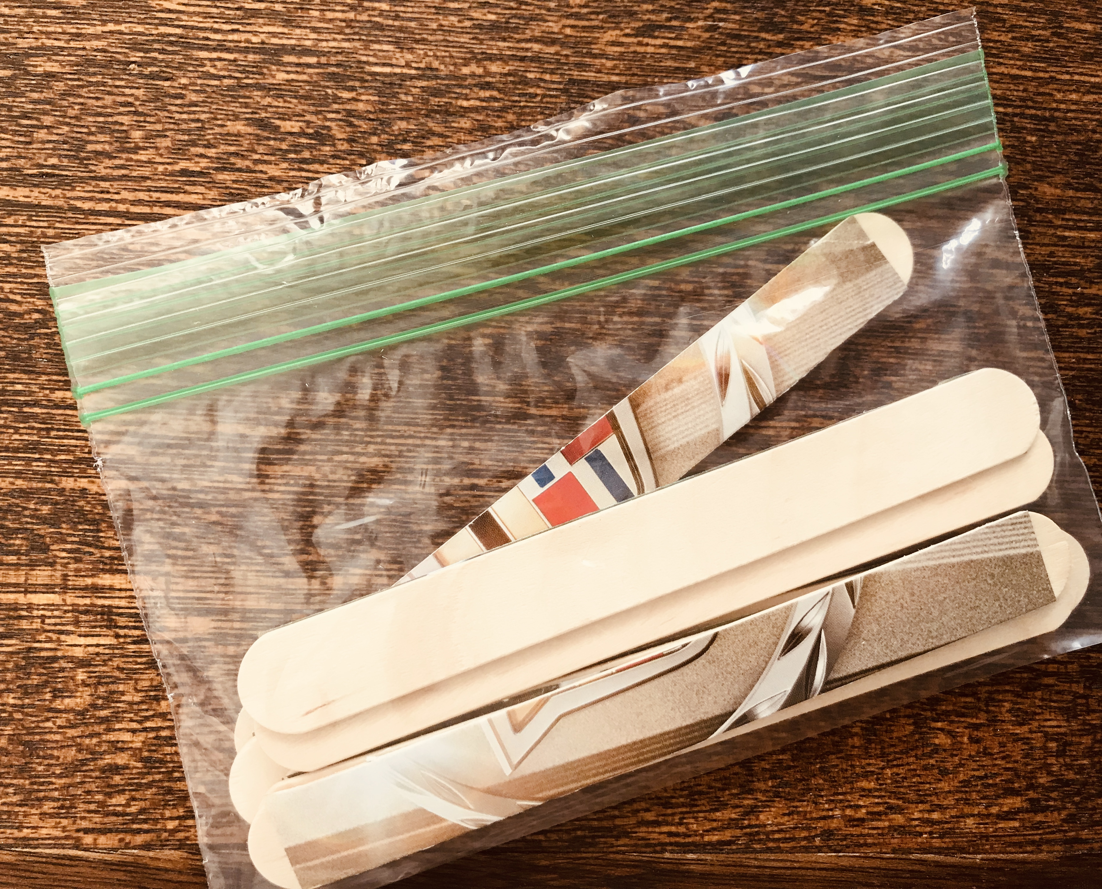 Popsicle stick image puzzle in a sealed bag