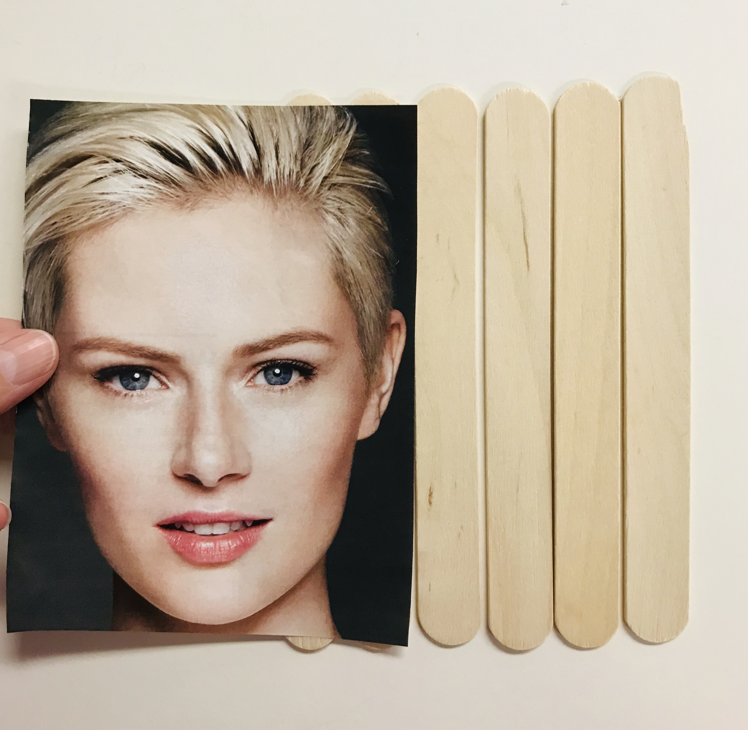 Blonde woman image and popsicle sticks